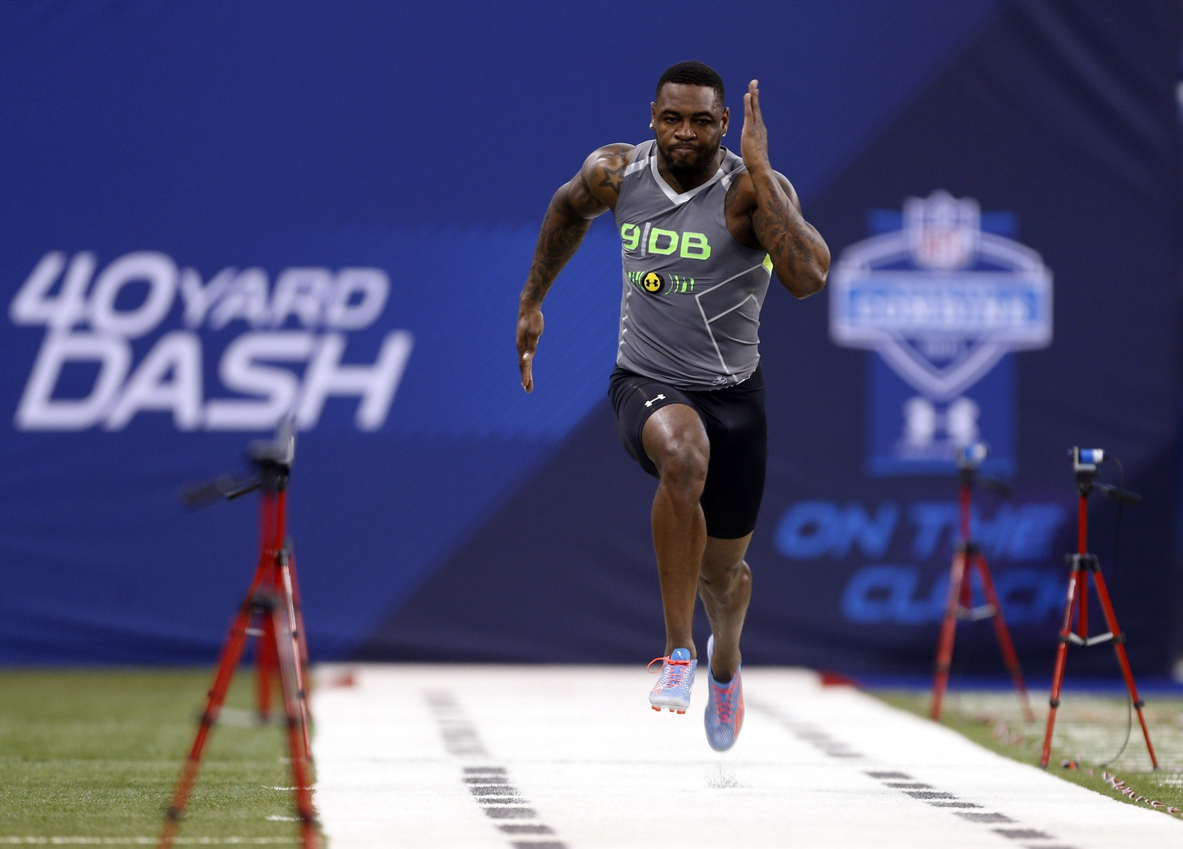 Feb 25, 2014; Indianapolis, IN, USA; Florida State Seminoles defensive back Terrence Brooks runs the 40 yard dash during the 2014 NFL Combine at Lucas Oil Stadium. Mandatory Credit: Brian Spurlock-USA TODAY Sports