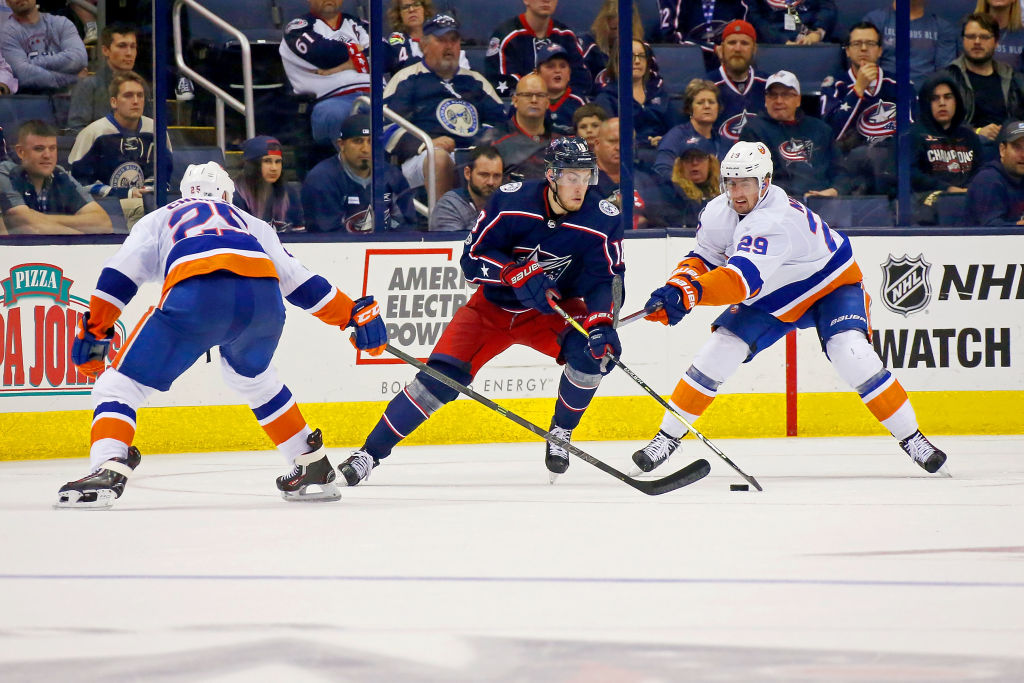 COLUMBUS, OH - OCTOBER 6: Pierre-Luc Dubois #18 of the Columbus Blue Jackets attempts to skate the puck past Jason Chimera #25 of the New York Islanders and Brock Nelson #29 of the New York Islanders during the third period on October 6, 2017 at Nationwide Arena in Columbus, Ohio. Columbus defeated New York 5-0. (Photo by Kirk Irwin/Getty Images)