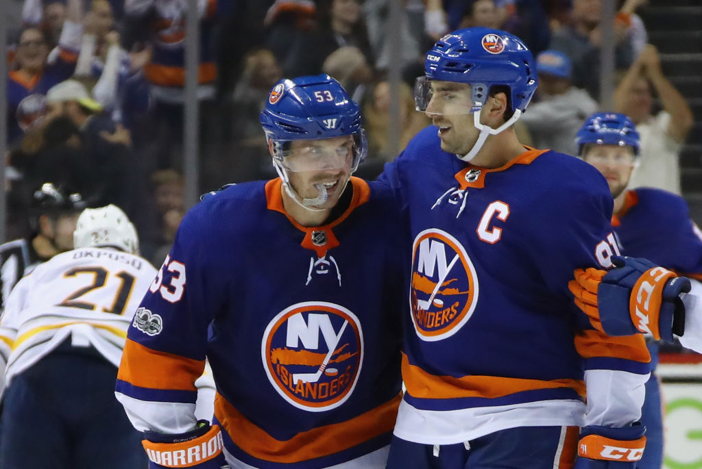 NEW YORK, NY - OCTOBER 07: (l-r) Casey Cizikas #53 and John Tavares #91 of the New York Islanders celebrate Cizikas's empty net goal against the Buffalo Sabres at the Barclays Center on October 7, 2017 in the Brooklyn borough of New York City. The Islanders defeated the Sabres 6-3. (Photo by Bruce Bennett/Getty Images)