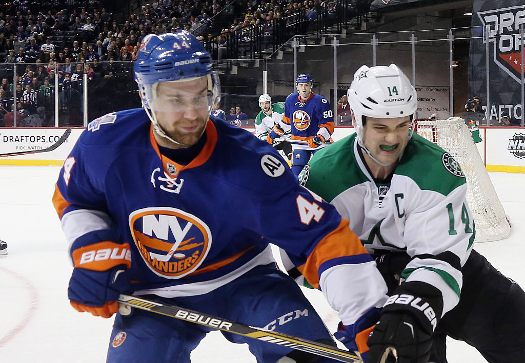 NEW YORK, NY - JANUARY 03: Calvin de Haan #44 of the New York Islanders fends off Jamie Benn #14 of the Dallas Stars skates against the New York Islanders at the Barclays Center on January 3, 2016 in the Brooklyn borough of New York City. The Islanders defeated the Stars 6-5. (Photo by Bruce Bennett/Getty Images)