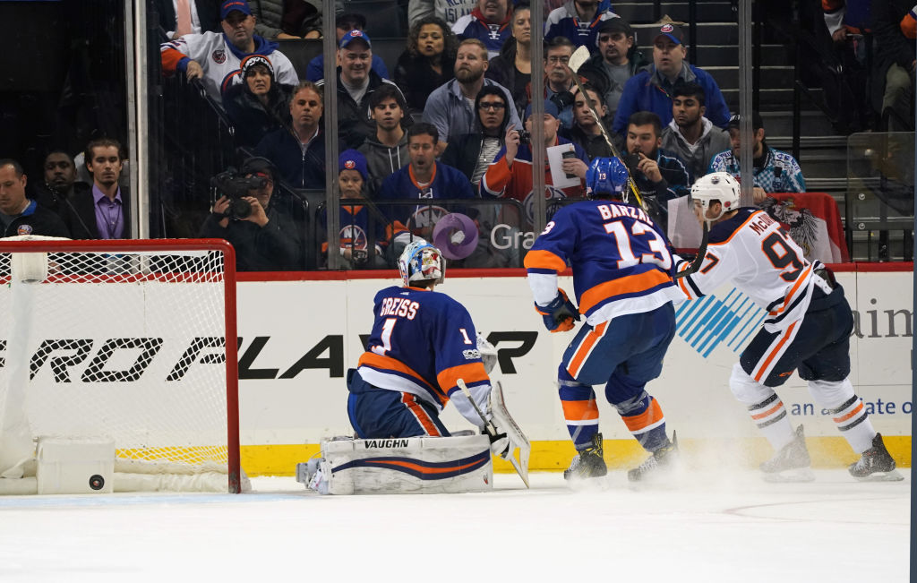 NEW YORK, NY - NOVEMBER 07: Connor McDavid #97 of the Edmonton Oilers celebrates his game winning overtime goal against Thomas Greiss #1 of the New York Islanders at the Barclays Center on November 7, 2017 in the Brooklyn borough of New York City. The Oilers defeated the Islanders 2-1 in overtime. (Photo by Bruce Bennett/Getty Images)
