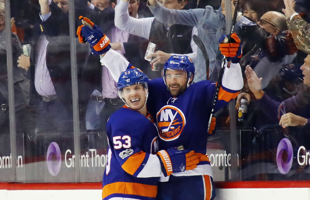 NEW YORK, NY - NOVEMBER 16: Johnny Boychuk #55 of the New York Islanders (r) celebrates his goal at 15:35 of the third period against the Carolina Hurricanes and is joined by Casey Cizikas #53 (l) at the Barclays Center on November 16, 2017 in the Brooklyn borough of New York City. (Photo by Bruce Bennett/Getty Images)