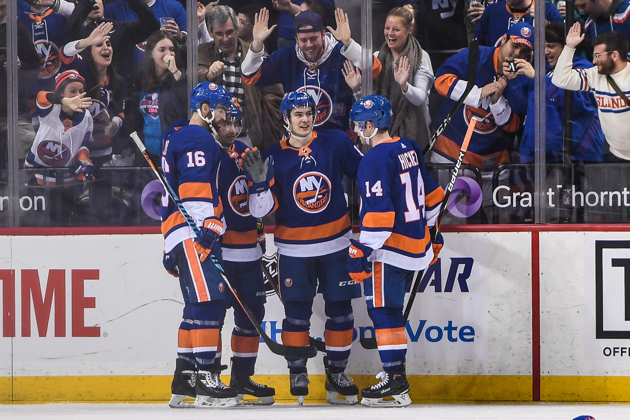 Dec 23, 2017; Brooklyn, NY, USA; New York Islanders center Mathew Barzal (13) celebrates his first hat trick during the third period between the New York Islanders and the Winnipeg Jets at Barclays Center. Mandatory Credit: Dennis Schneidler-USA TODAY Sports