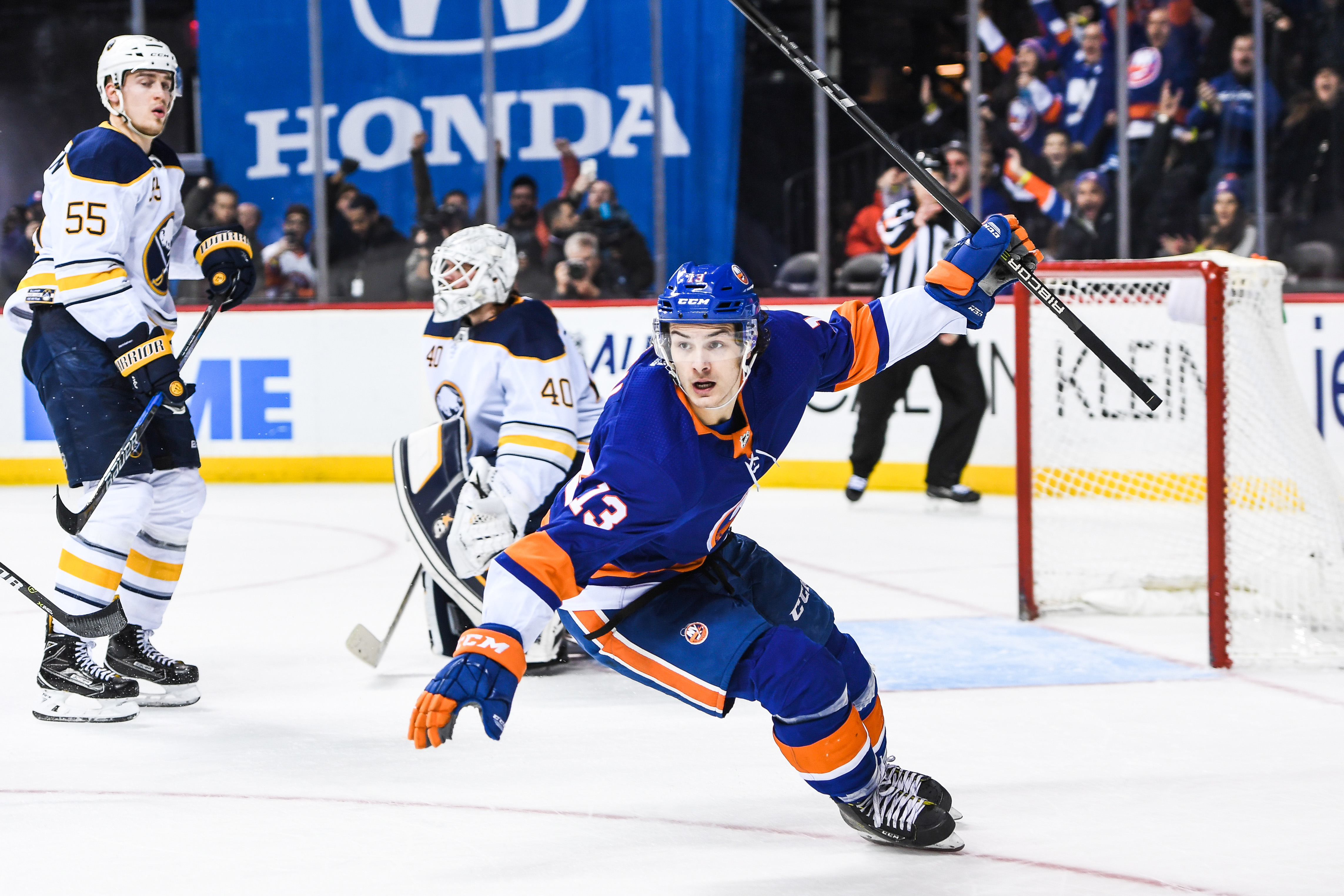 Dec 27, 2017; Brooklyn, NY, USA; New York Islanders center Mathew Barzal (13) celebrates his goal in overtime to win the game 3-2 during the overtime period go the game between the New York Islanders and the Buffalo Sabres at Barclays Center. Mandatory Credit: Dennis Schneidler-USA TODAY Sports