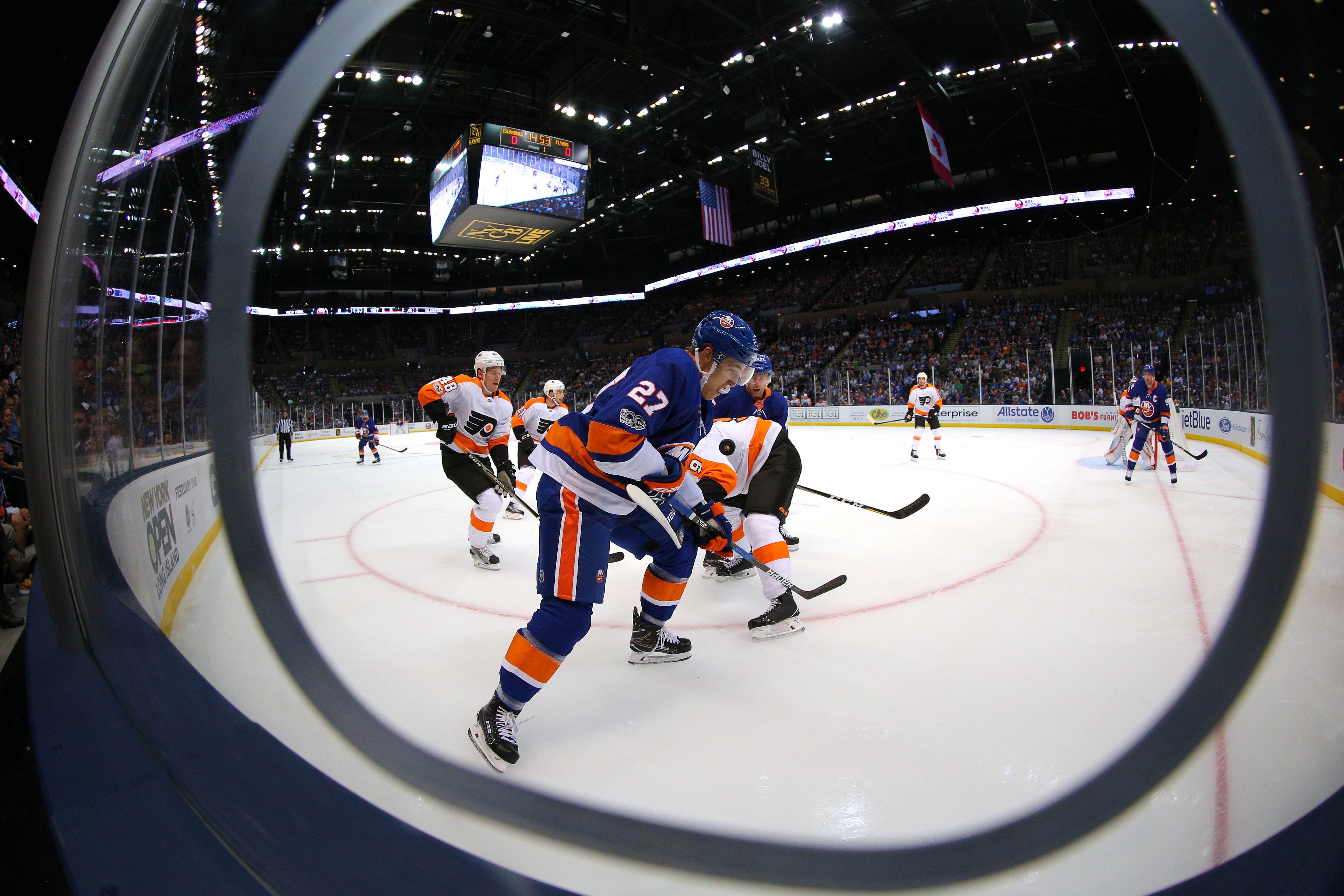 Sep 17, 2017; Uniondale, NY, USA; New York Islanders center Anders Lee (27) and Philadelphia Flyers defenseman Ivan Provorov (9) fight for the puck during the first period of a preseason game at NYCB Live at the Nassau Veterans Memorial Coliseum. Mandatory Credit: Brad Penner-USA TODAY Sports
