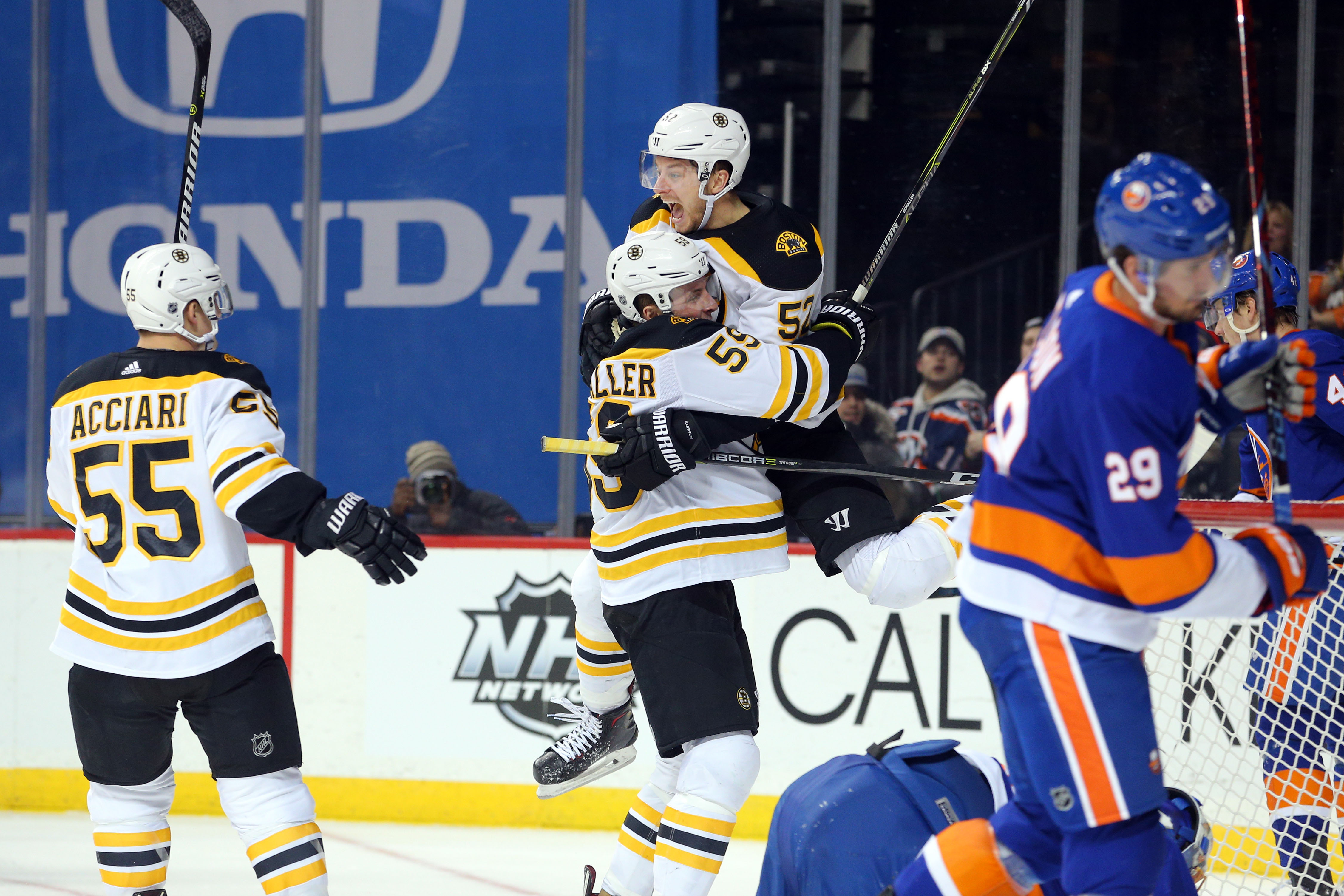 Jan 2, 2018; Brooklyn, NY, USA; Boston Bruins left wing Tim Schaller (59) celebrates his goal against the New York Islanders with Boston Bruins center Sean Kuraly (52) during the third period at Barclays Center. Mandatory Credit: Brad Penner-USA TODAY Sports