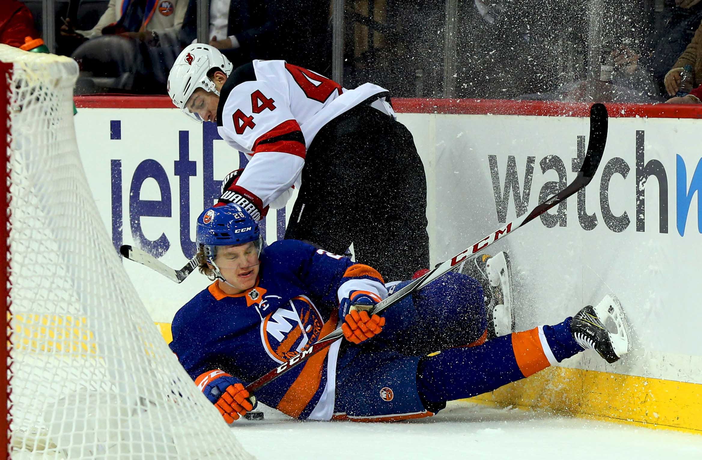 Jan 16, 2018; Brooklyn, NY, USA; New Jersey Devils left wing Miles Wood (44) and New York Islanders defenseman Sebastian Aho (28) collide at the boards during the first period at Barclays Center. Mandatory Credit: Andy Marlin-USA TODAY Sports