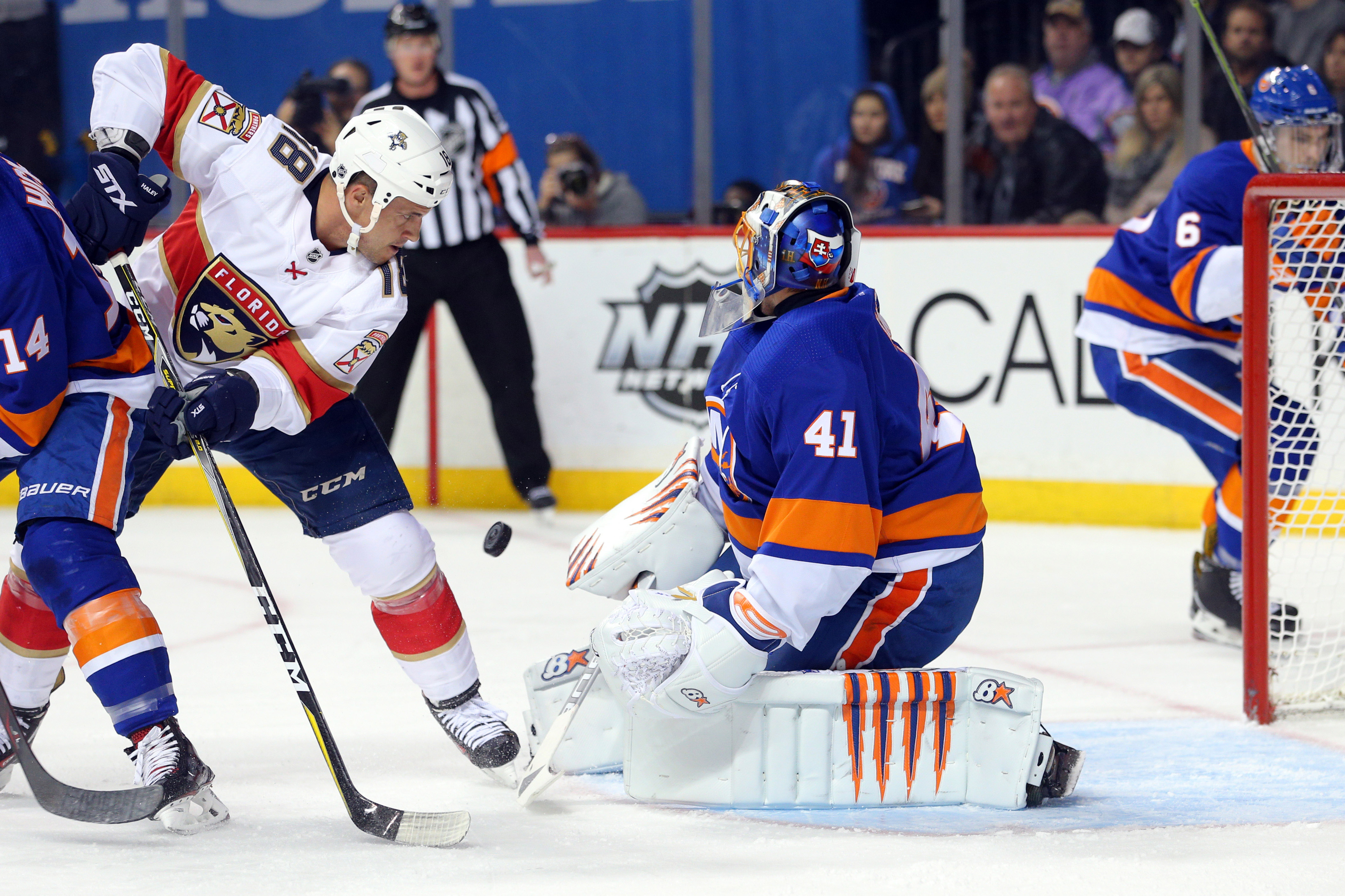 Jan 30, 2018; Brooklyn, NY, USA; New York Islanders goalie Jaroslav Halak (41) allows a goal to Florida Panthers defenseman Michael Matheson (not pictured) in front of Panthers center Micheal Haley (18) during the first period at Barclays Center. Mandatory Credit: Brad Penner-USA TODAY Sports