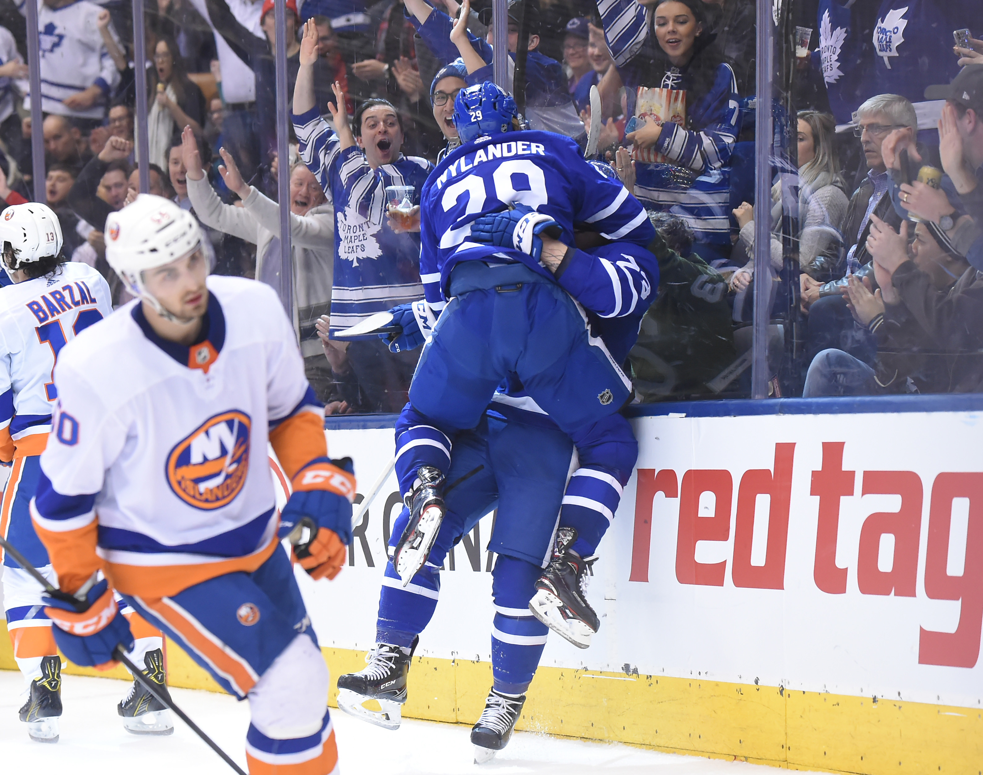 Jan 31, 2018; Toronto, Ontario, CAN; Toronto Maple Leafs forward William Nylander (29) jumps in celebration on defenceman Travis Dermott (23, obscured) after Dermott scored his first career NHL goal against New York Islanders i the second period at Air Canada Centre. Mandatory Credit: Dan Hamilton-USA TODAY Sports