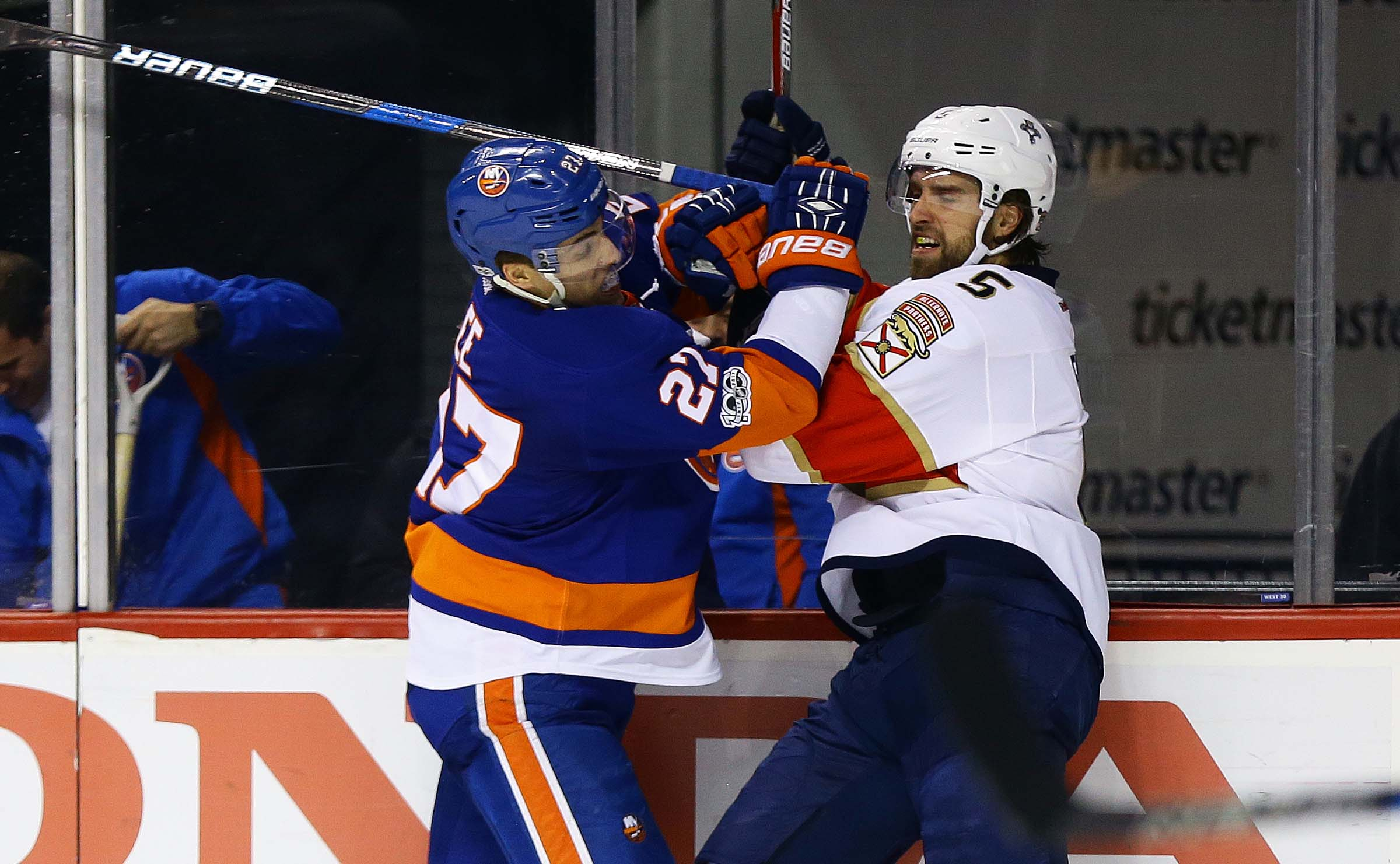Jan 11, 2017; Brooklyn, NY, USA; New York Islanders left wing Anders Lee (27) and Florida Panthers defenseman Aaron Ekblad (5) come together at the boards during the second period at Barclays Center. Mandatory Credit: Andy Marlin-USA TODAY Sports