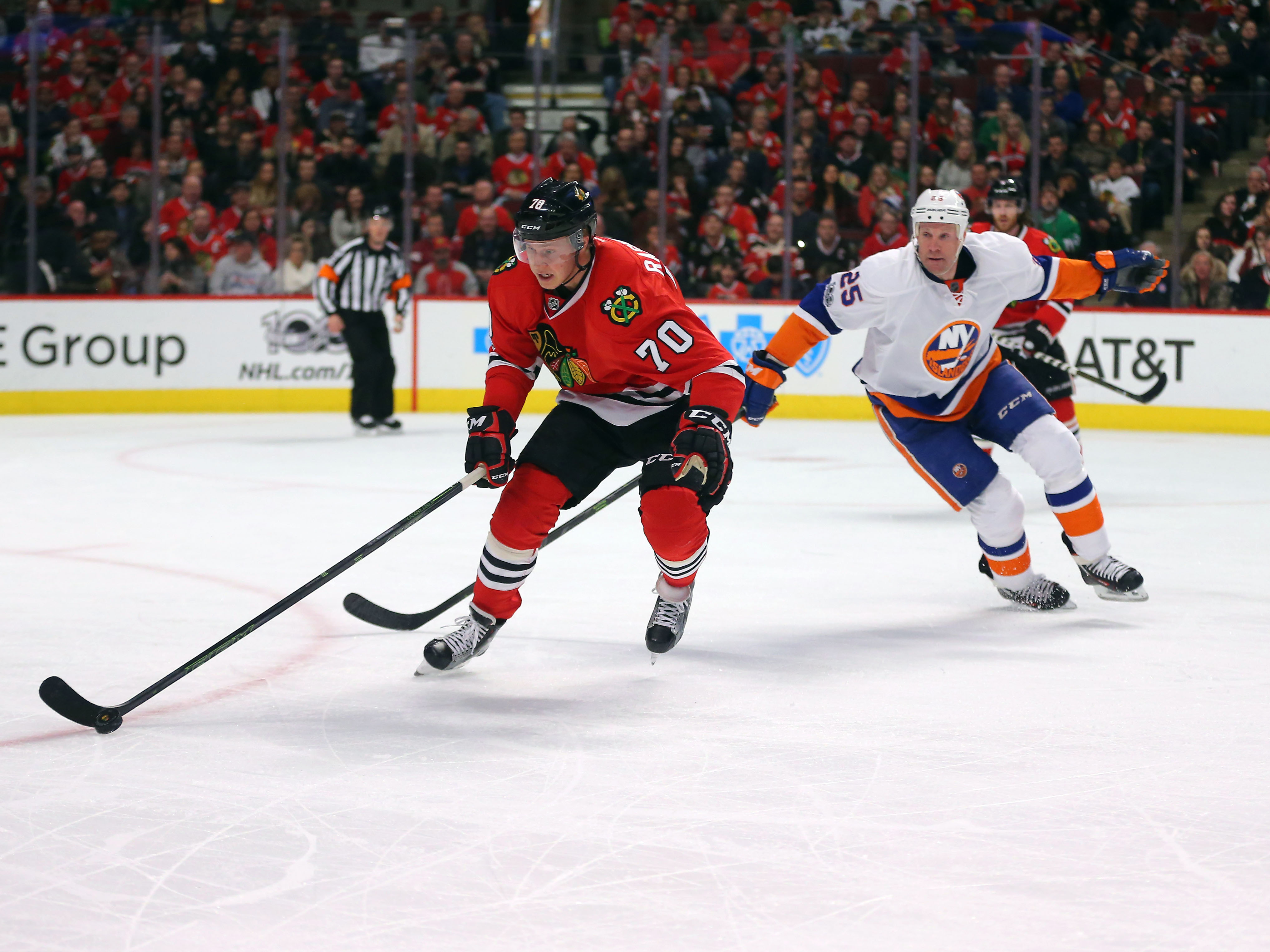 Mar 3, 2017; Chicago, IL, USA; Chicago Blackhawks center Dennis Rasmussen (70) is pursued by New York Islanders left wing Jason Chimera (25) during the second period at the United Center. Mandatory Credit: Dennis Wierzbicki-USA TODAY Sports
