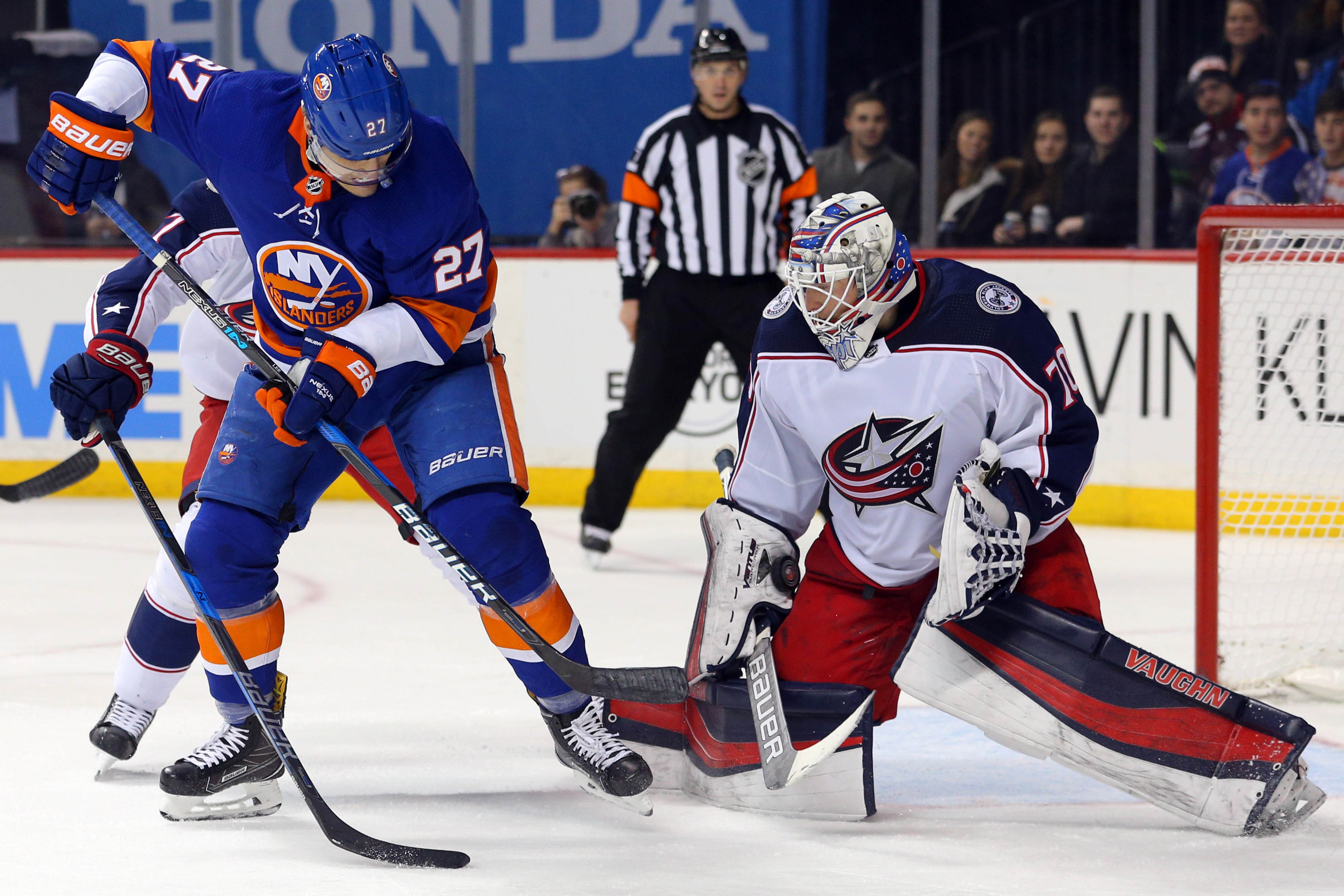 Feb 3, 2018; Brooklyn, NY, USA; Columbus Blue Jackets goalie Joonas Korpisalo (70) makes a save against New York Islanders center Anders Lee (27) during the second period at Barclays Center. Mandatory Credit: Brad Penner-USA TODAY Sports