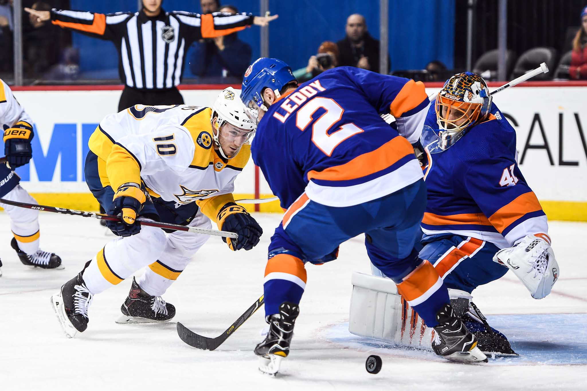 Feb 5, 2018; Brooklyn, NY, USA; New York Islanders goaltender Jaroslav Halak (41) makes a save and Nashville Predators center Colton Sissons (10) and New York Islanders defenseman Nick Leddy (2) fight over the loose puck during the first period at Barclays Center. Mandatory Credit: Dennis Schneidler-USA TODAY Sports