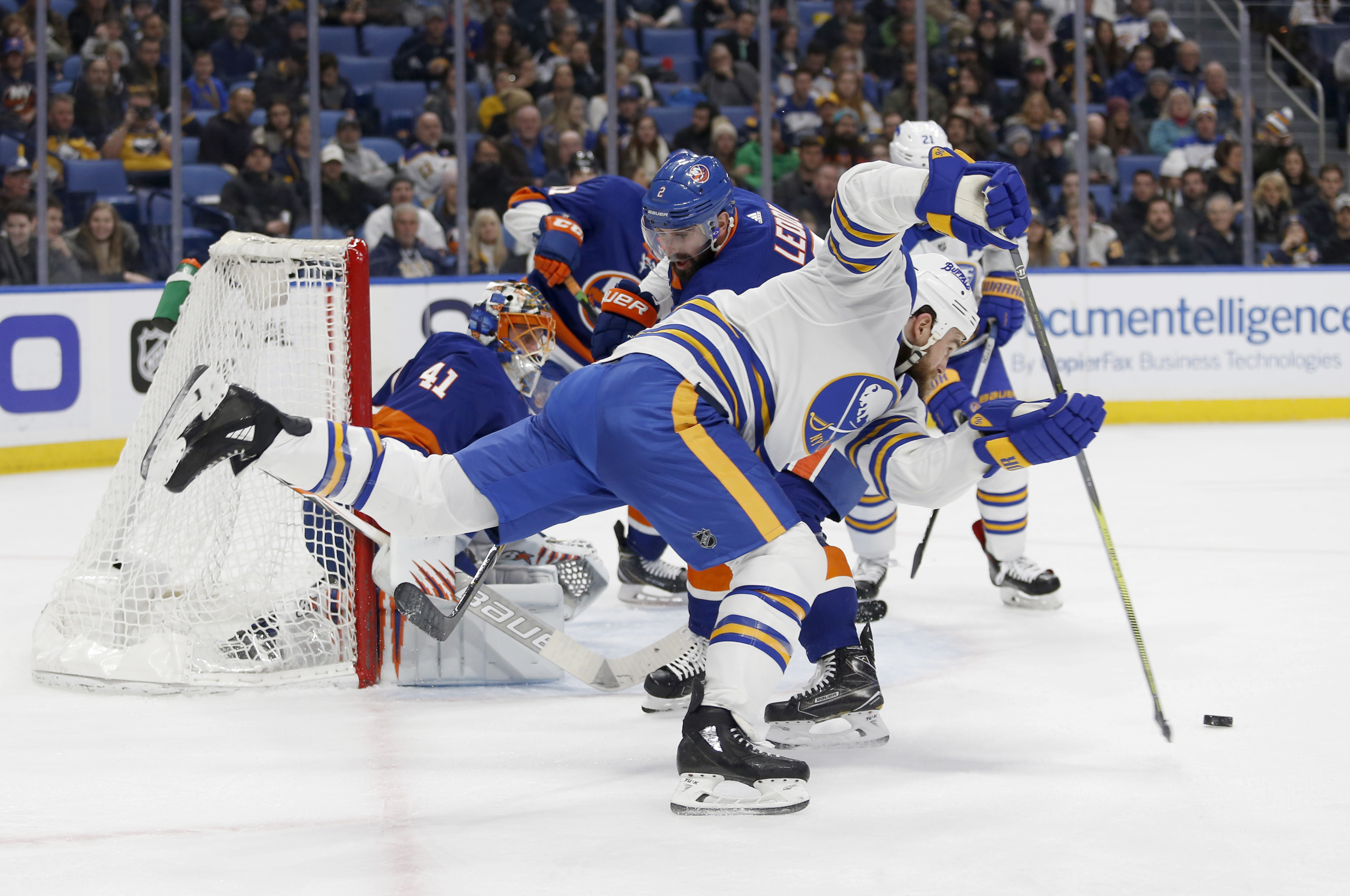 Feb 8, 2018; Buffalo, NY, USA; Buffalo Sabres center Ryan O'Reilly (90) dives to take a shot on goal during the second period against the New York Islanders at KeyBank Center. Mandatory Credit: Timothy T. Ludwig-USA TODAY Sports