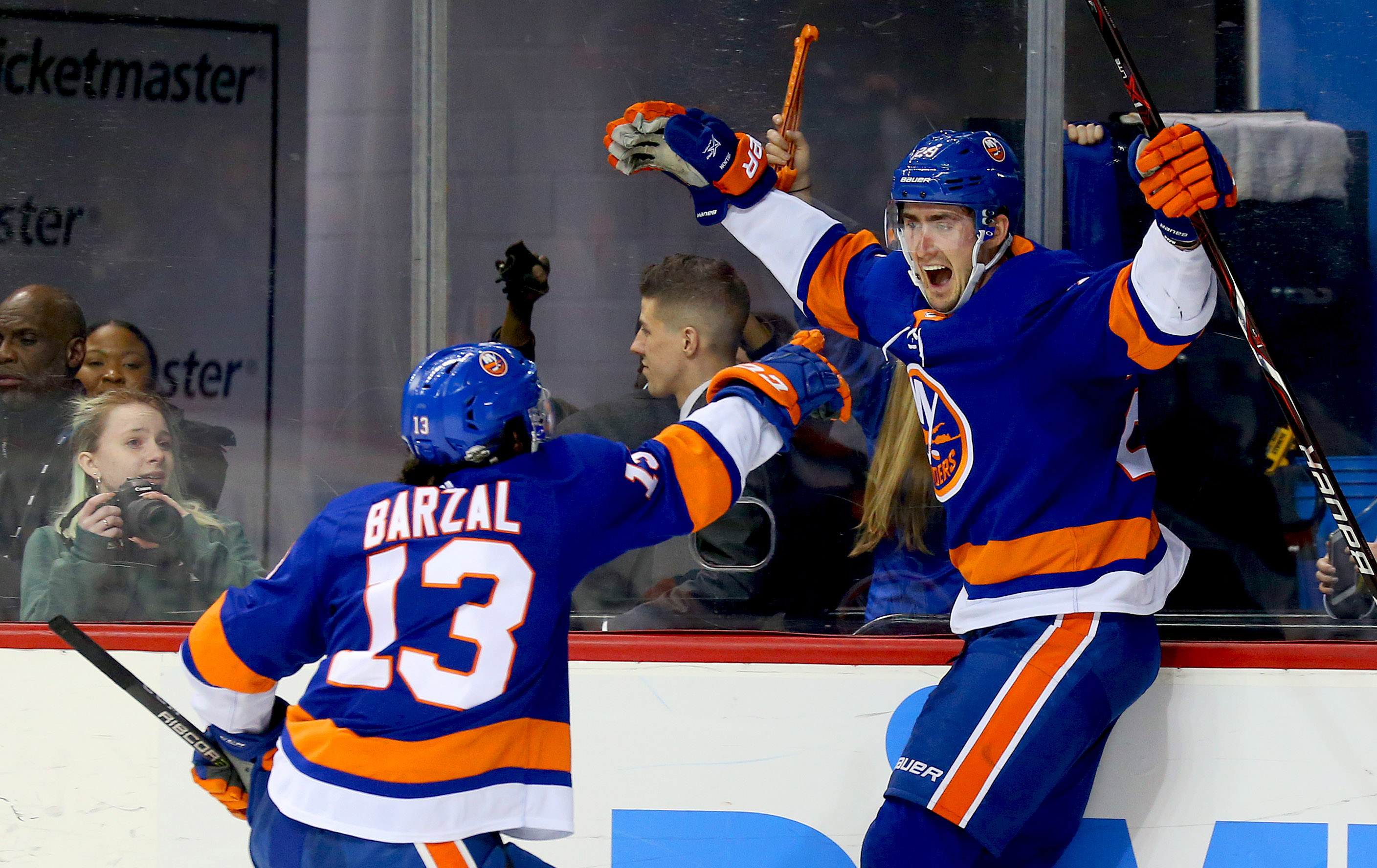 Feb 9, 2018; Brooklyn, NY, USA; New York Islanders center Brock Nelson (29) celebrates with center Mathew Barzal (13) after Nelson scored the game winning goal in overtime against the Detroit Red Wings at Barclays Center. Mandatory Credit: Andy Marlin-USA TODAY Sports
