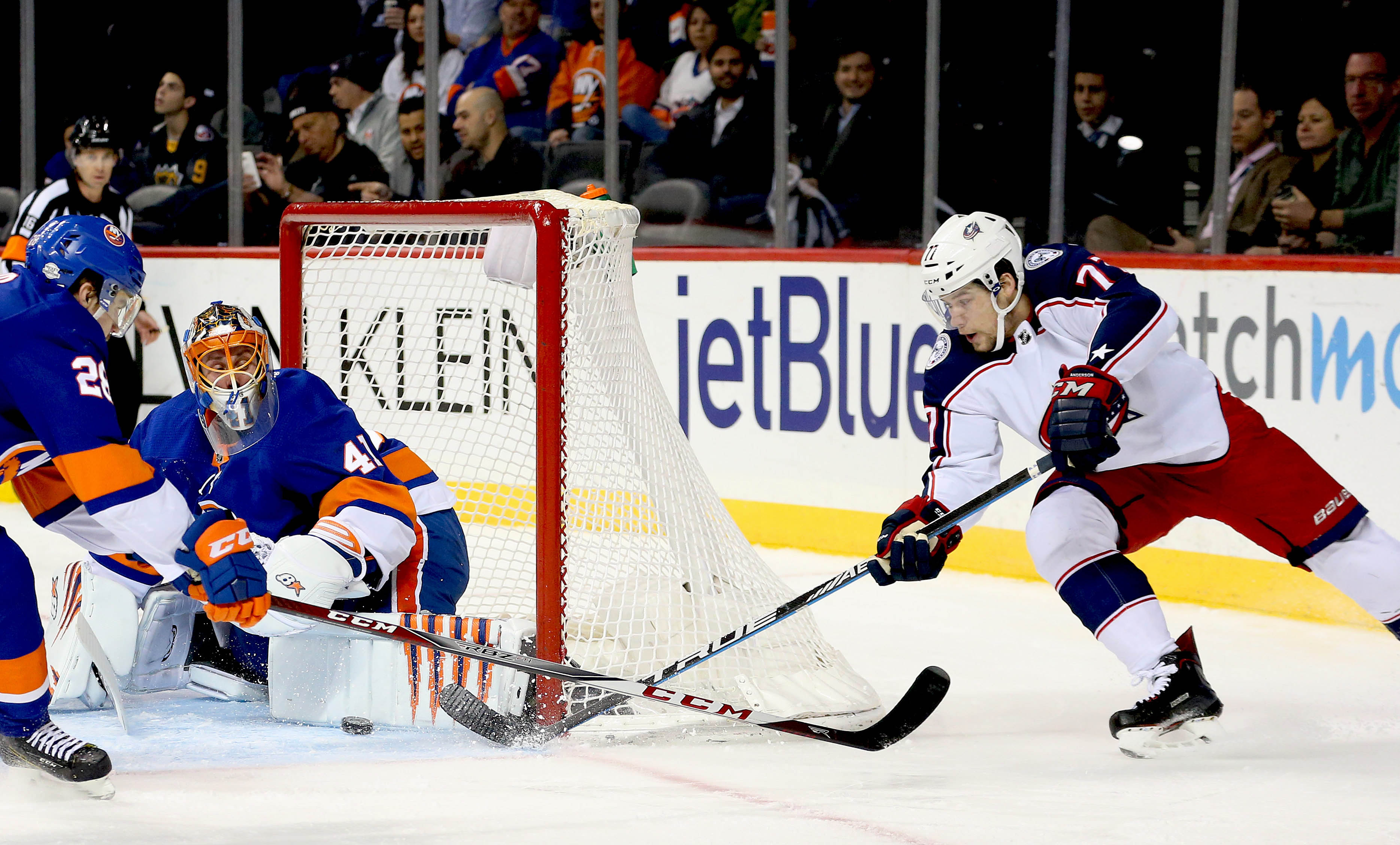 Feb 13, 2018; Brooklyn, NY, USA; New York Islanders goaltender Jaroslav Halak (41) makes a save on a wrap around shot by Columbus Blue Jackets right wing Josh Anderson (77) during the first period at Barclays Center. Mandatory Credit: Andy Marlin-USA TODAY Sports