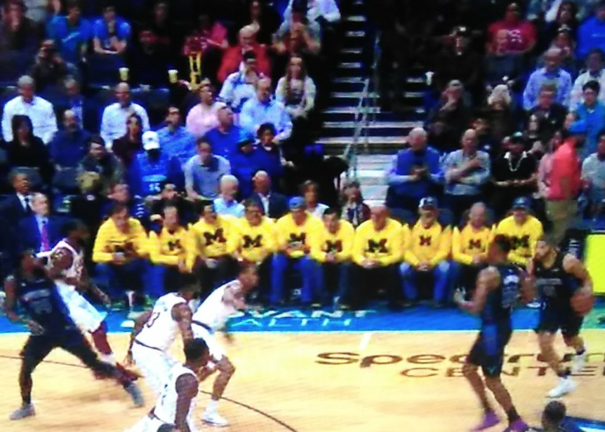 LOOK: Michigan fans make their presence felt courtside at Hornets game