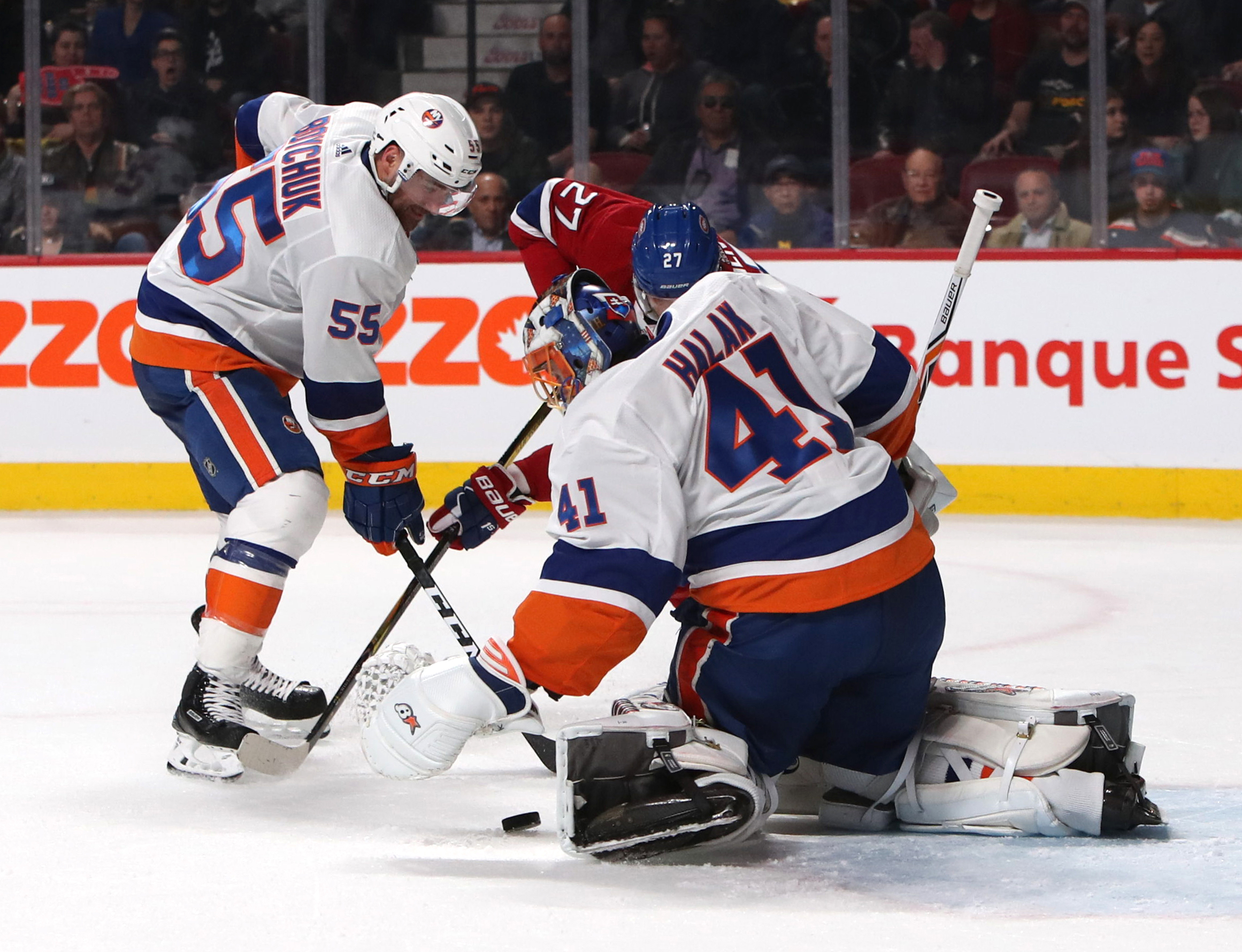 Feb 28, 2018; Montreal, Quebec, CAN; New York Islanders goaltender Jaroslav Halak (41) makes a save against Montreal Canadiens left wing Alex Galchenyuk (27) as defenseman Johnny Boychuk (55) defends during the second period at Bell Centre. Mandatory Credit: Jean-Yves Ahern-USA TODAY Sports