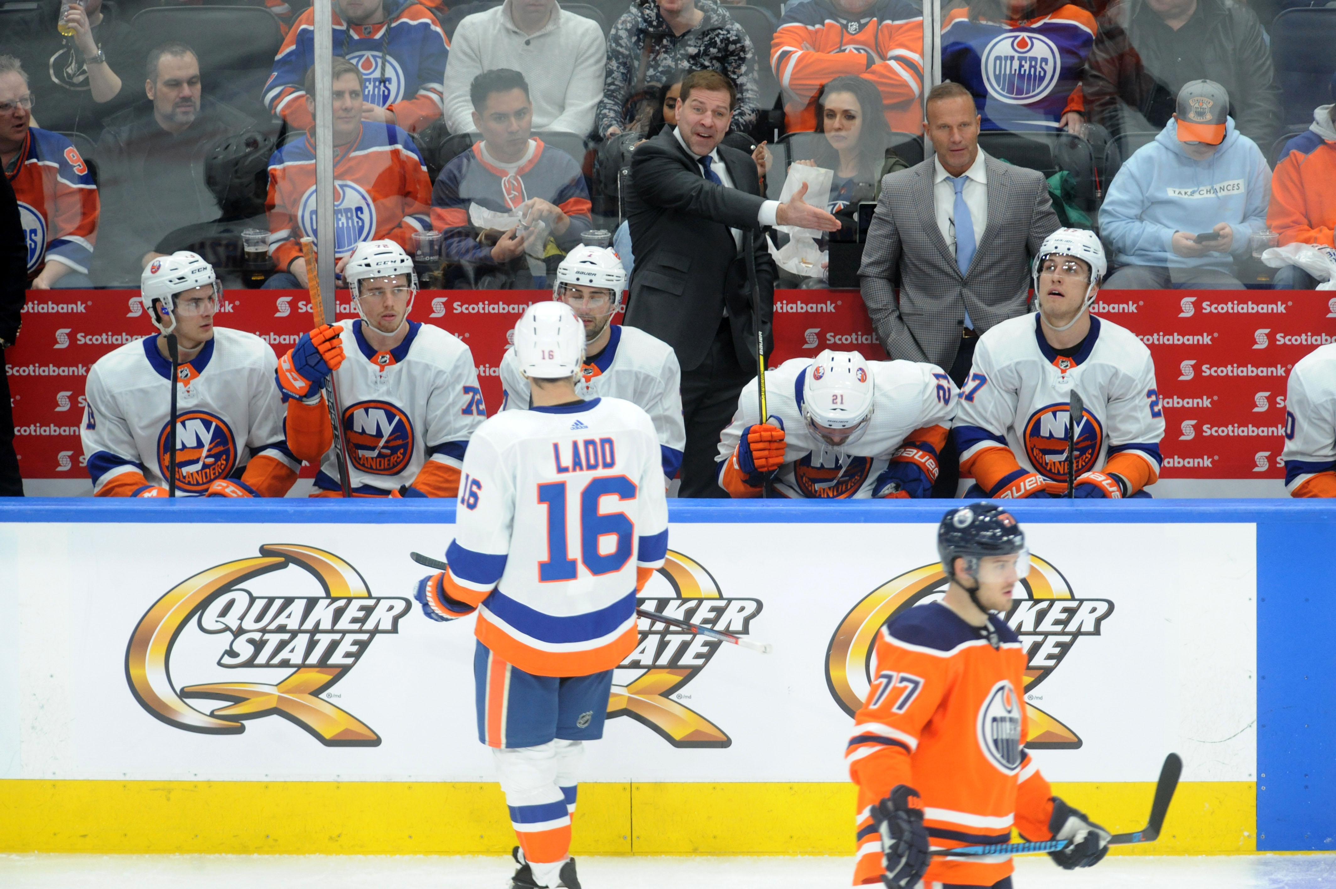 Mar 8, 2018; Edmonton, Alberta, CAN; New York Islanders Head Coach Doug Weight is seen on the players bench as they played the Edmonton Oilers during the third period at Rogers Place. Oilers won in a shootout 2-1. Mandatory Credit: Walter Tychnowicz-USA TODAY Sports