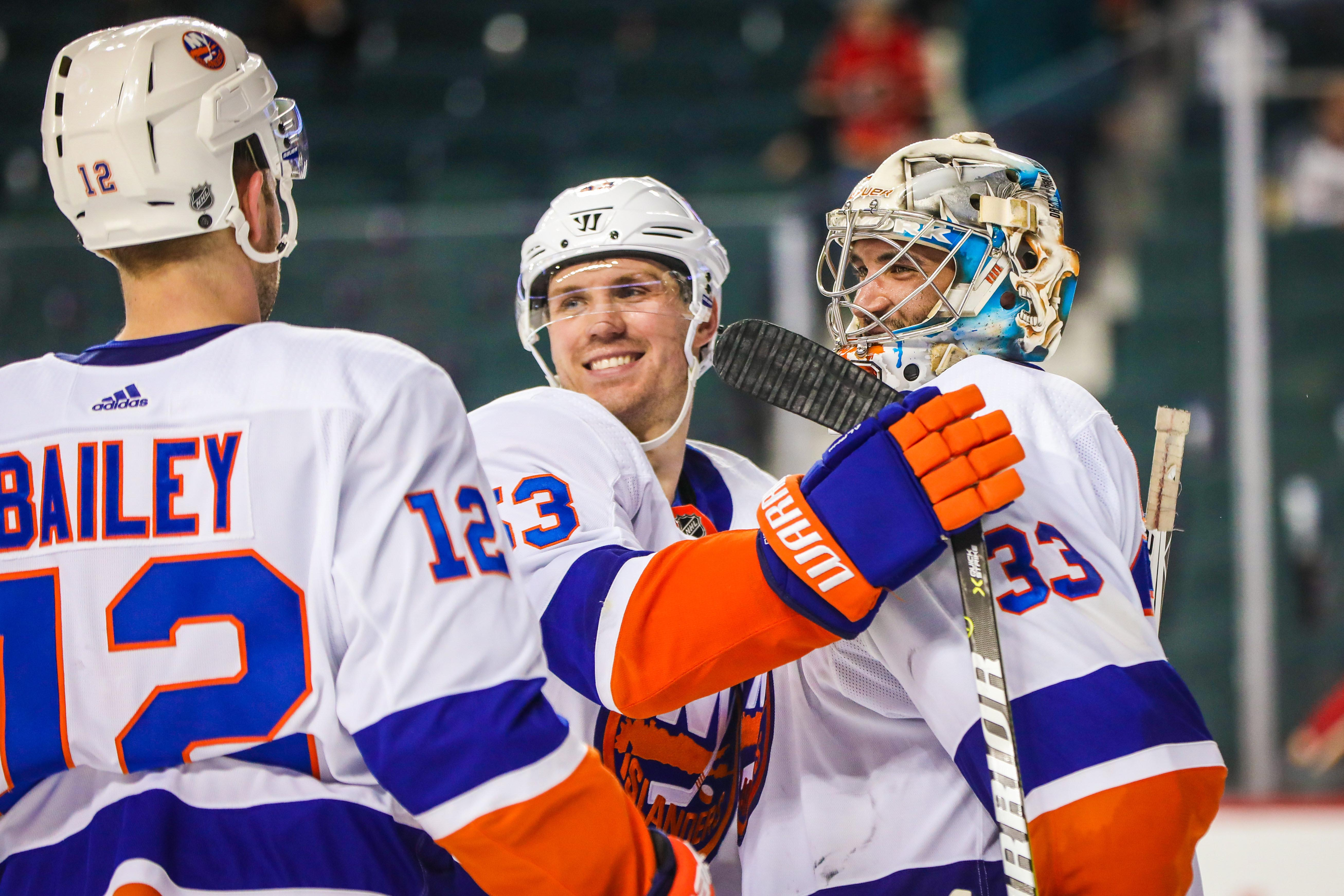 Mar 11, 2018; Calgary, Alberta, CAN; New York Islanders goaltender Christopher Gibson (33) celebrate with teammates after defeating the Calgary Flames at Scotiabank Saddledome. Mandatory Credit: Sergei Belski-USA TODAY Sports