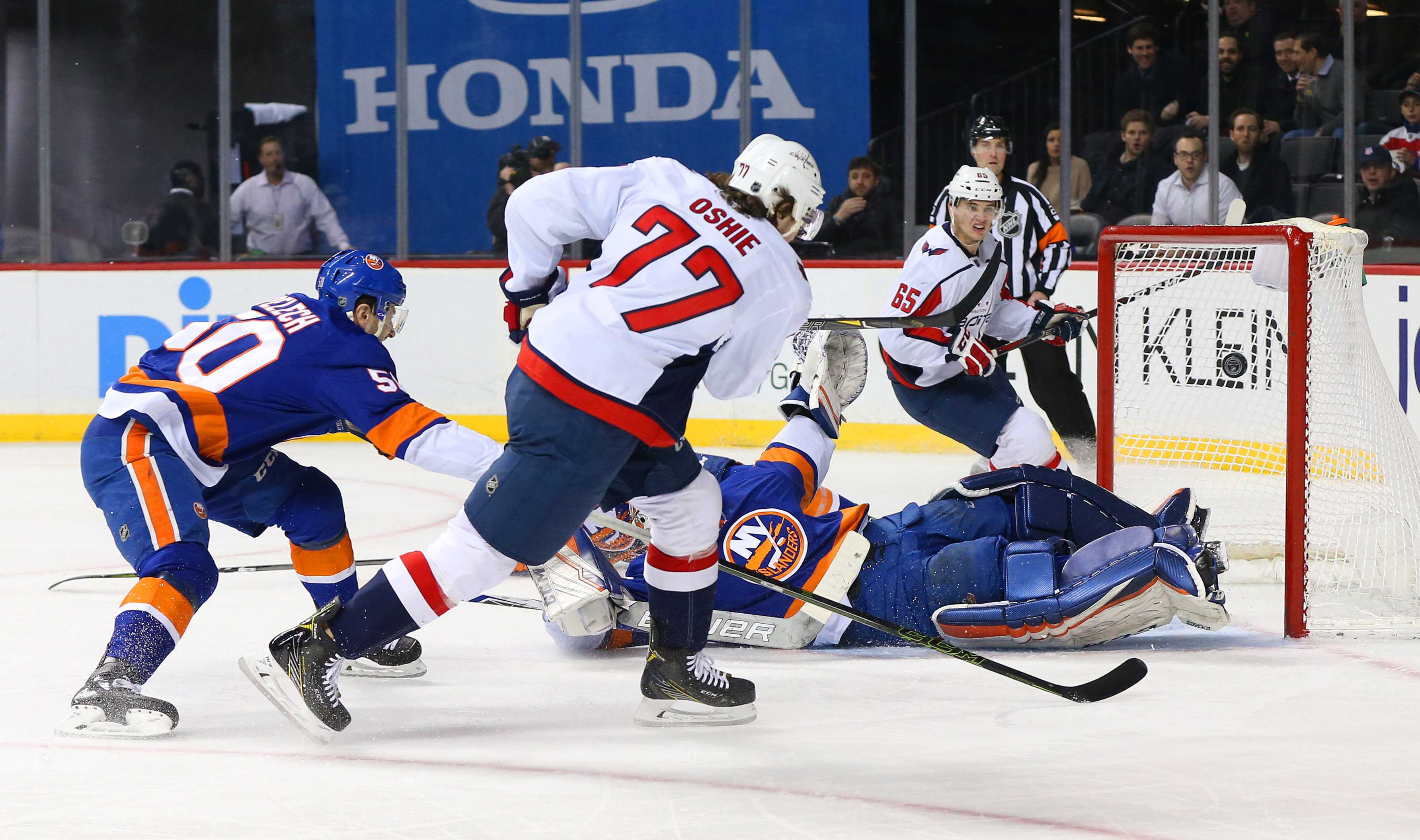 Mar 15, 2018; Brooklyn, NY, USA; Washington Capitals right wing T.J. Oshie (77) scores a goal a against the New York Islanders during the first period at Barclays Center. Mandatory Credit: Andy Marlin-USA TODAY Sports