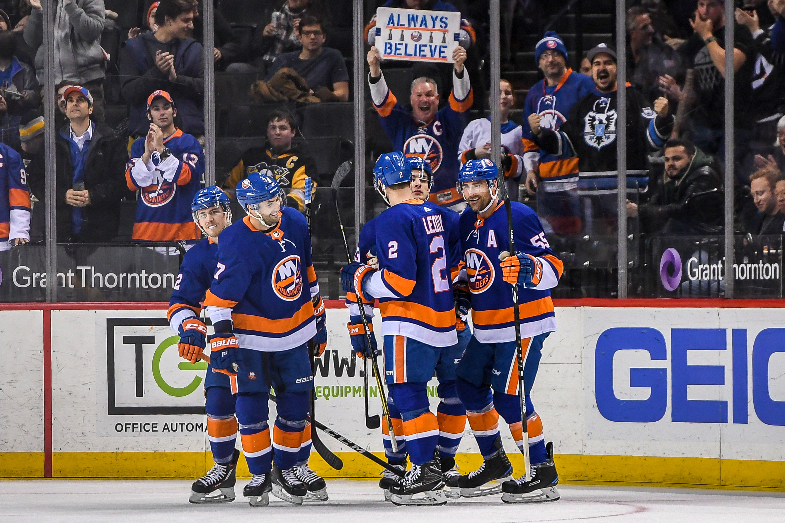 Mar 20, 2018; Brooklyn, NY, USA; New York Islanders celebrate the goal by New York Islanders center Mathew Barzal (13) against the Pittsburgh Penguins during the first period at Barclays Center. Mandatory Credit: Dennis Schneidler-USA TODAY Sports