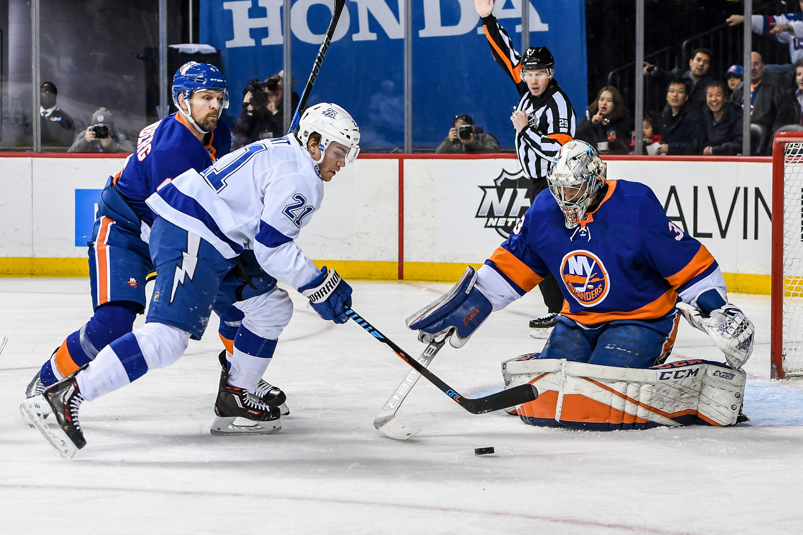 Mar 22, 2018; Brooklyn, NY, USA; Tampa Bay Lightning center Brayden Point (21) shoots against New York Islanders goaltender Christopher Gibson (33) during the first period at Barclays Center. Mandatory Credit: Dennis Schneidler-USA TODAY Sports