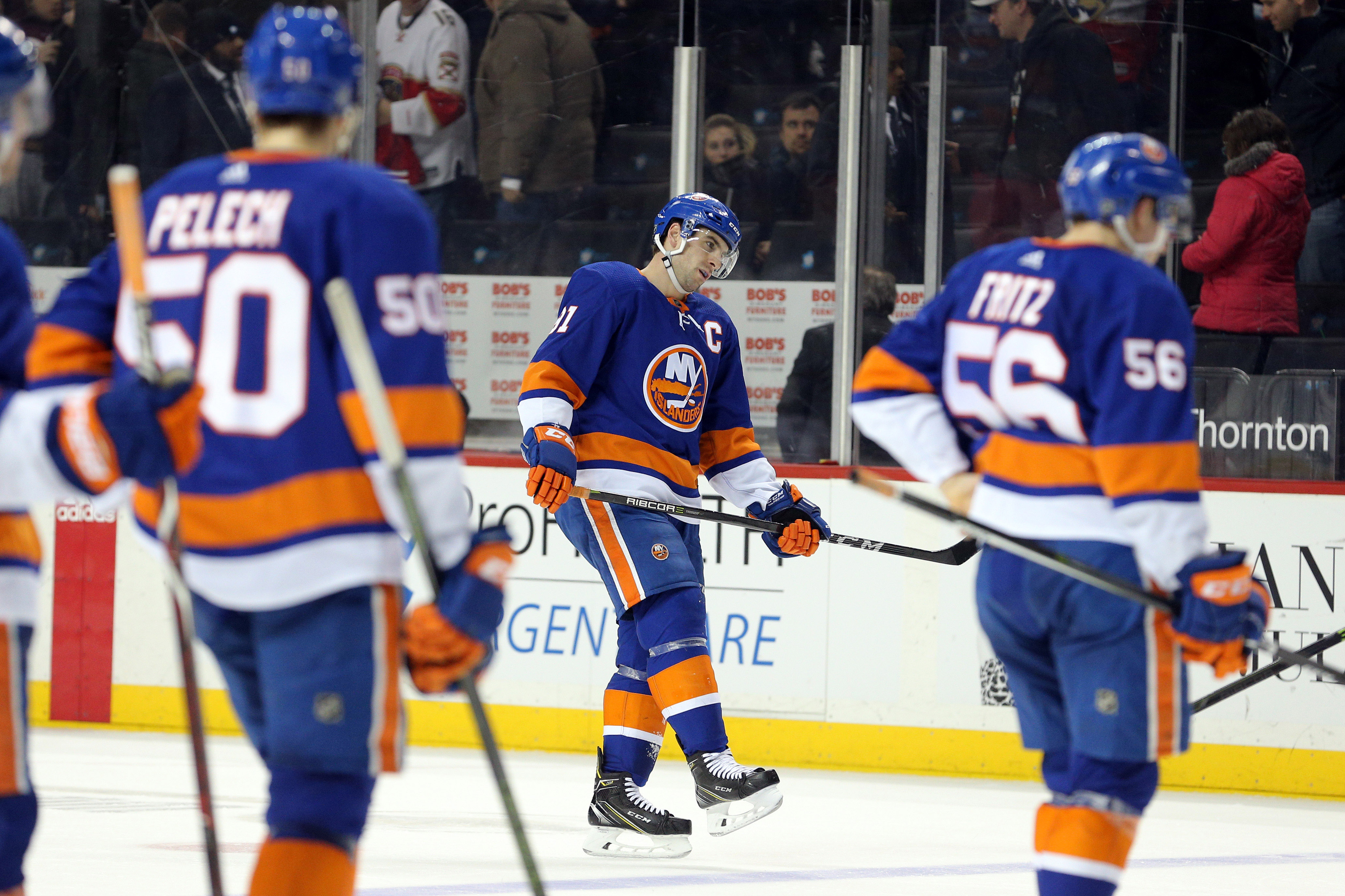 Mar 26, 2018; Brooklyn, NY, USA; New York Islanders center John Tavares (91) reacts as he skates off the ice after losing to the Florida Panthers at Barclays Center. Mandatory Credit: Brad Penner-USA TODAY Sports