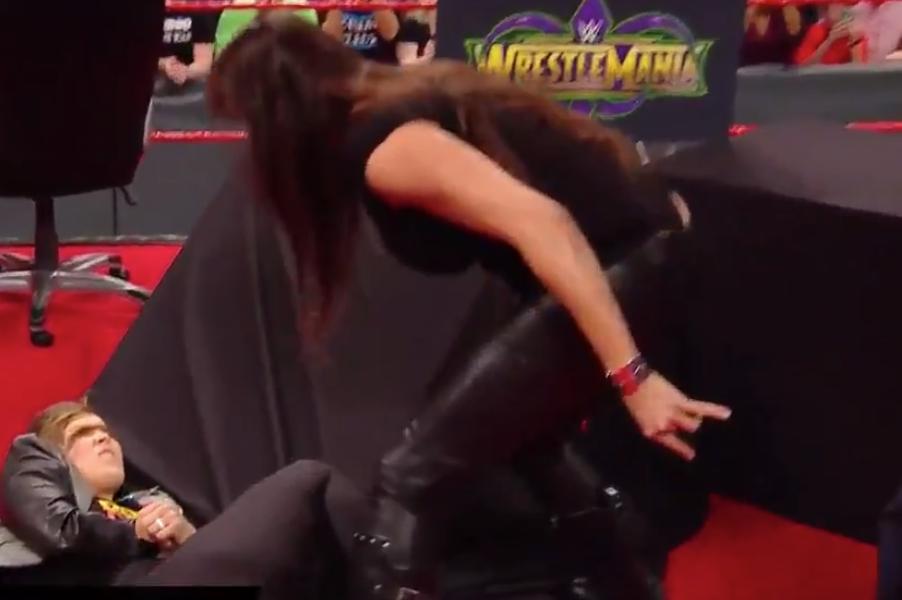 Ronda Rousey slammed through a table by Stephanie McMahon