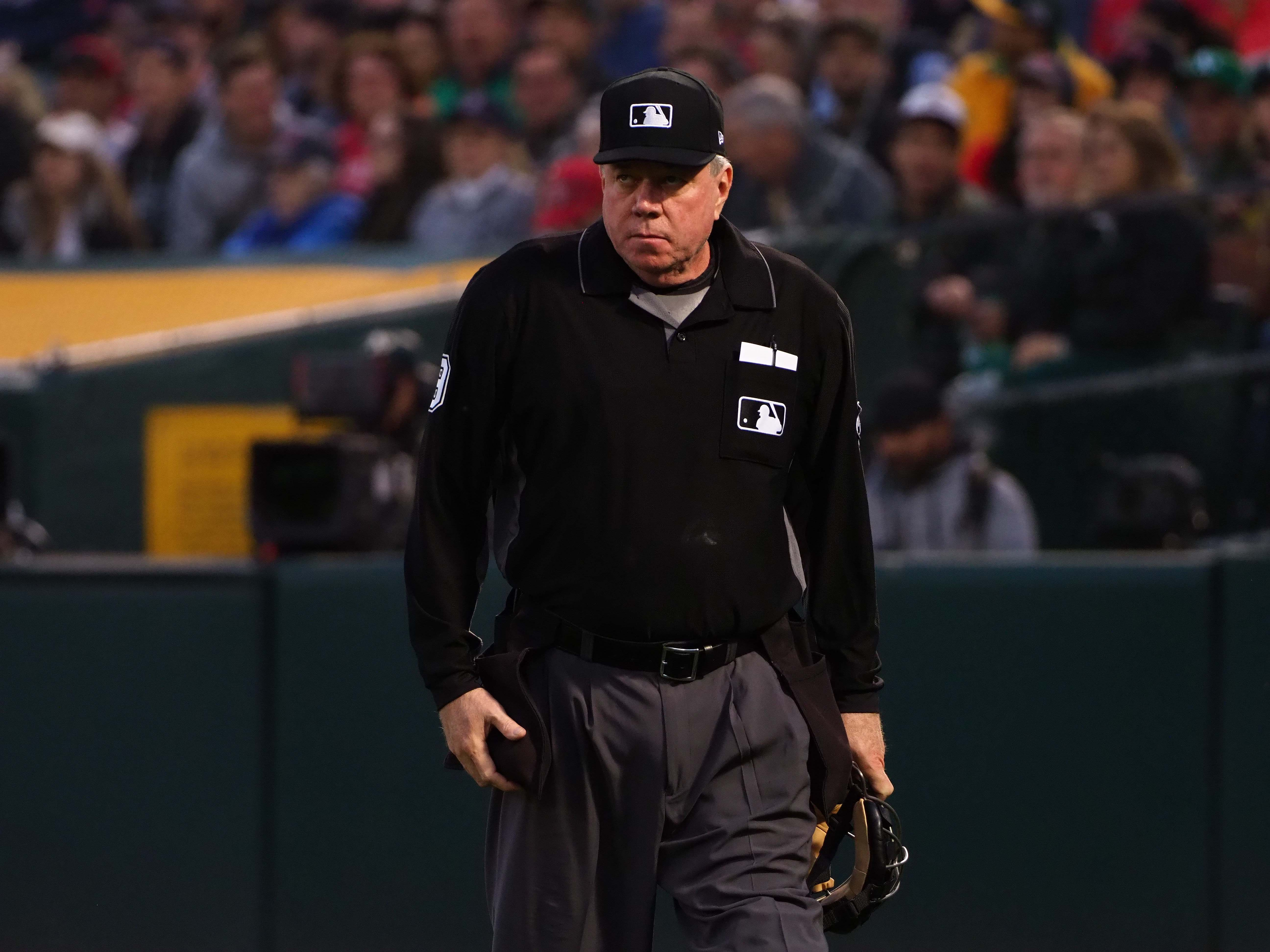 Cubs coach throws drink at umpire in disgust
