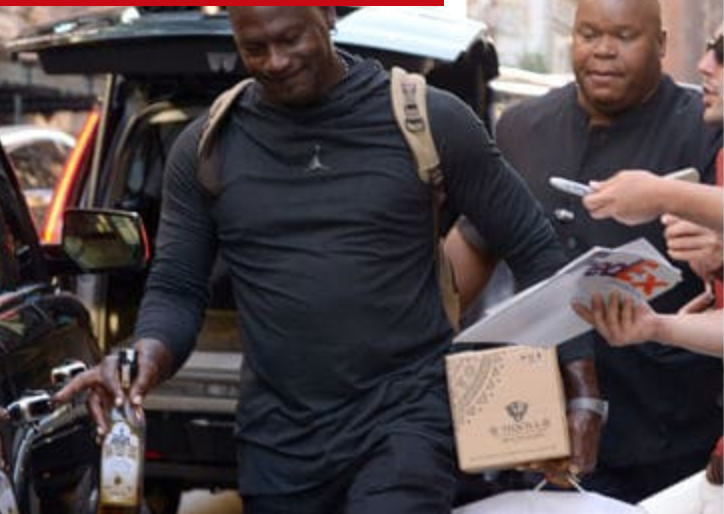 Michael Jordan walks around NYC with tequila bottle to celebrate biggest shot of his career