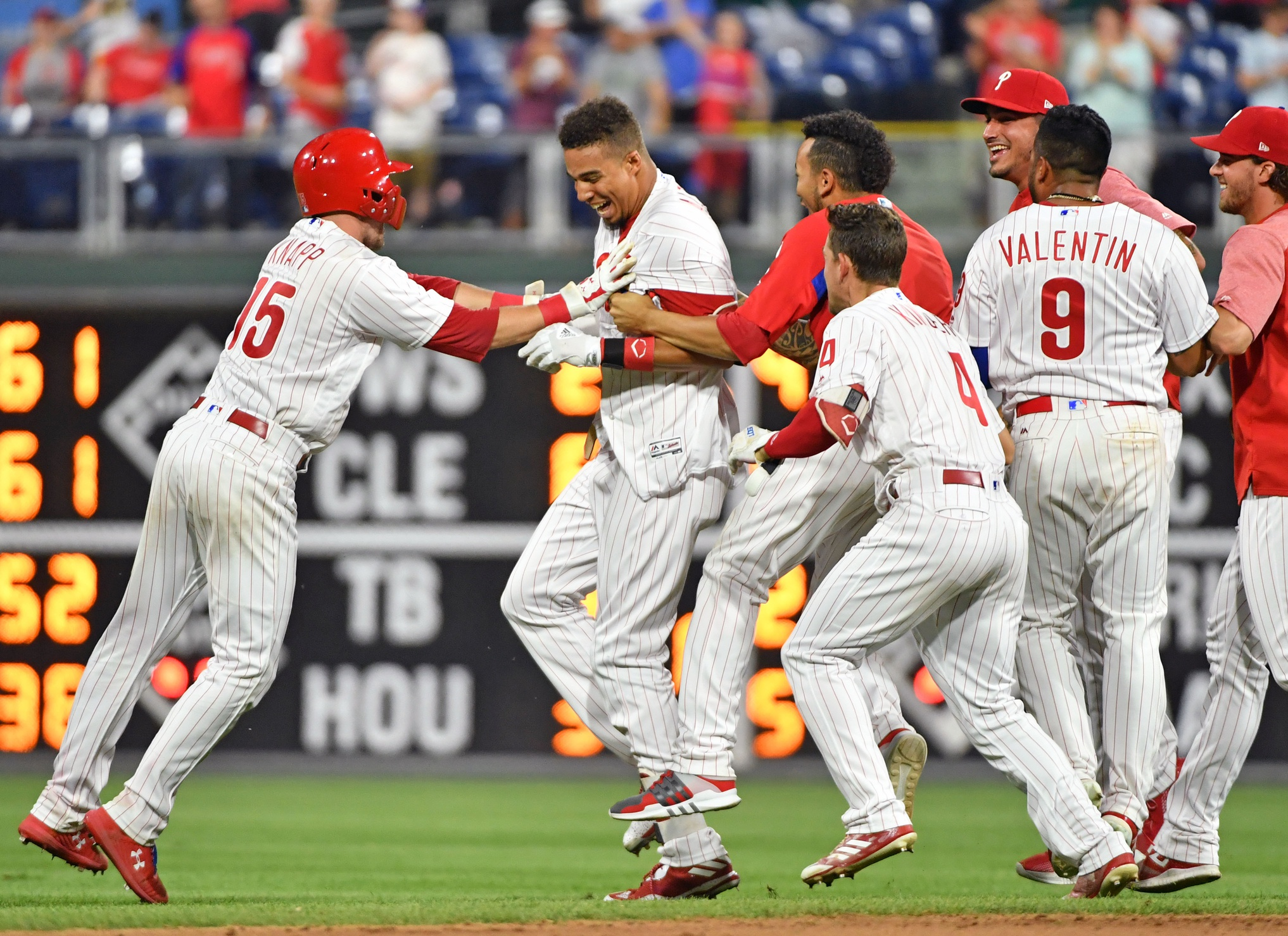 Phillies win wild extra inning game despite nearly giving game away
