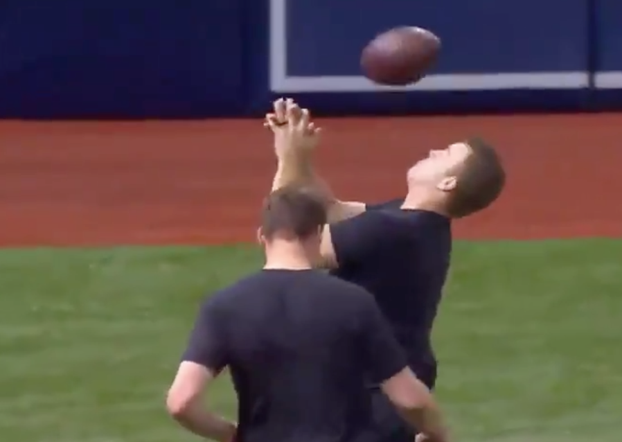 Watch: Orioles pitcher David Hess gets drilled in face by football in warmups