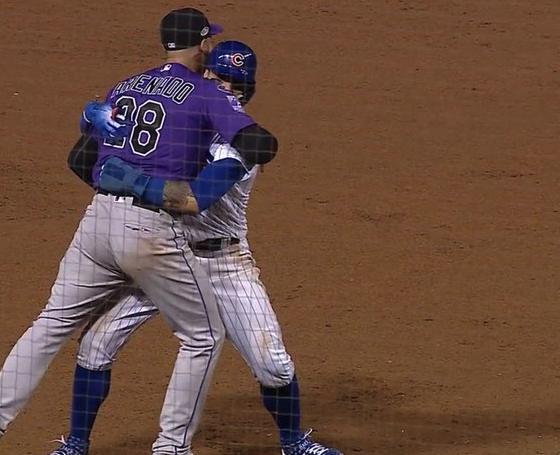Javier Baez, Nolan Arenado hugging on basepath sparks great memes