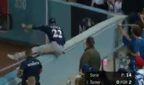 Watch: Christian Yelich makes great running catch, flips over railing