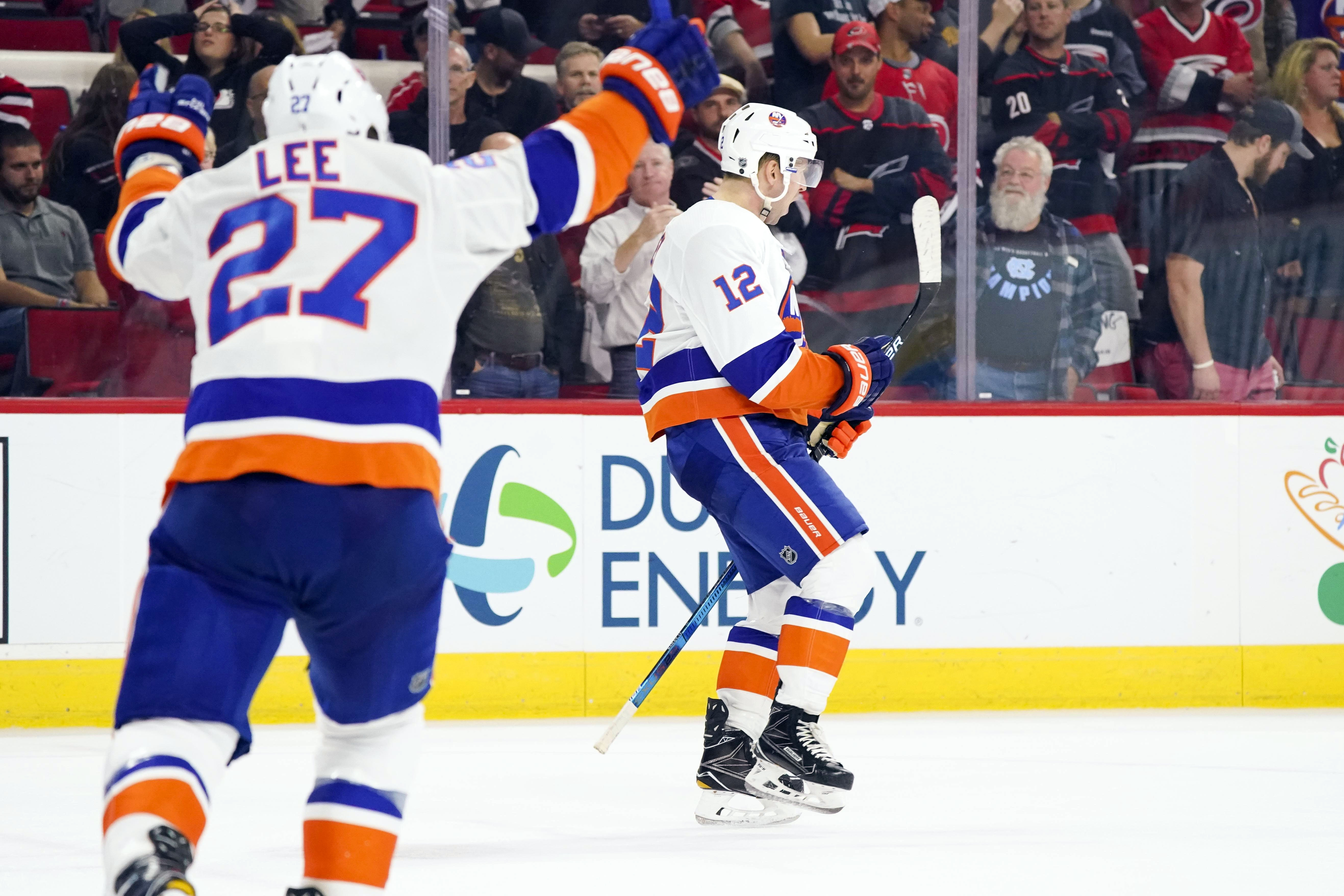 Oct 4, 2018; Raleigh, NC, USA; New York Islanders right wing Josh Bailey (12) celebrates his game winning overtime goal against the Carolina Hurricanes at PNC Arena. The New York Islanders defeated the Carolina Hurricanes 2-1 in the overtime. Mandatory Credit: James Guillory-USA TODAY Sports