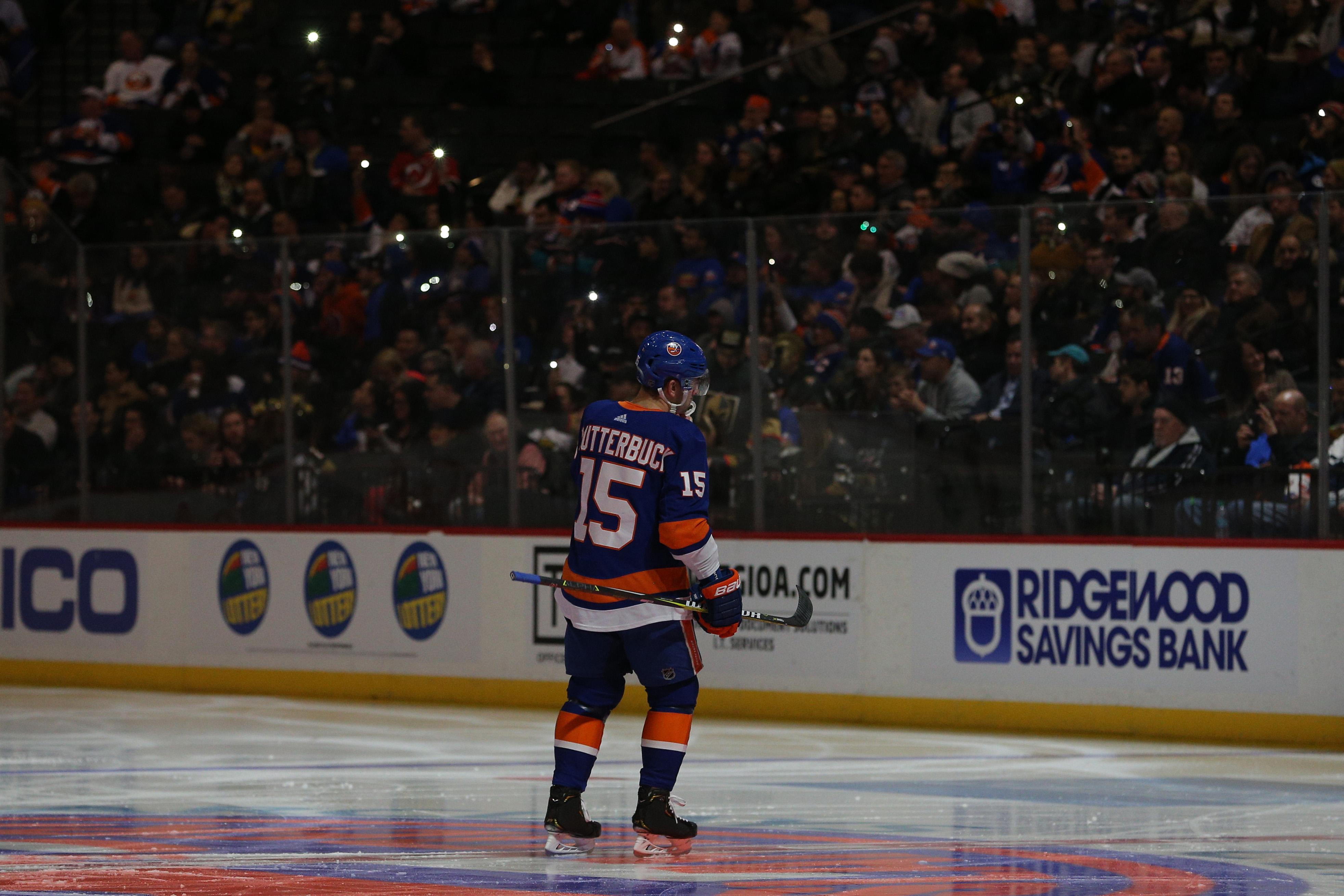 Dec 12, 2018; Brooklyn, NY, USA; Fans hold up cellphone lights from the stands during a lighting delay before the start of the third period between the New York Islanders and the Vegas Golden Knights at Barclays Center. Mandatory Credit: Brad Penner-USA TODAY Sports