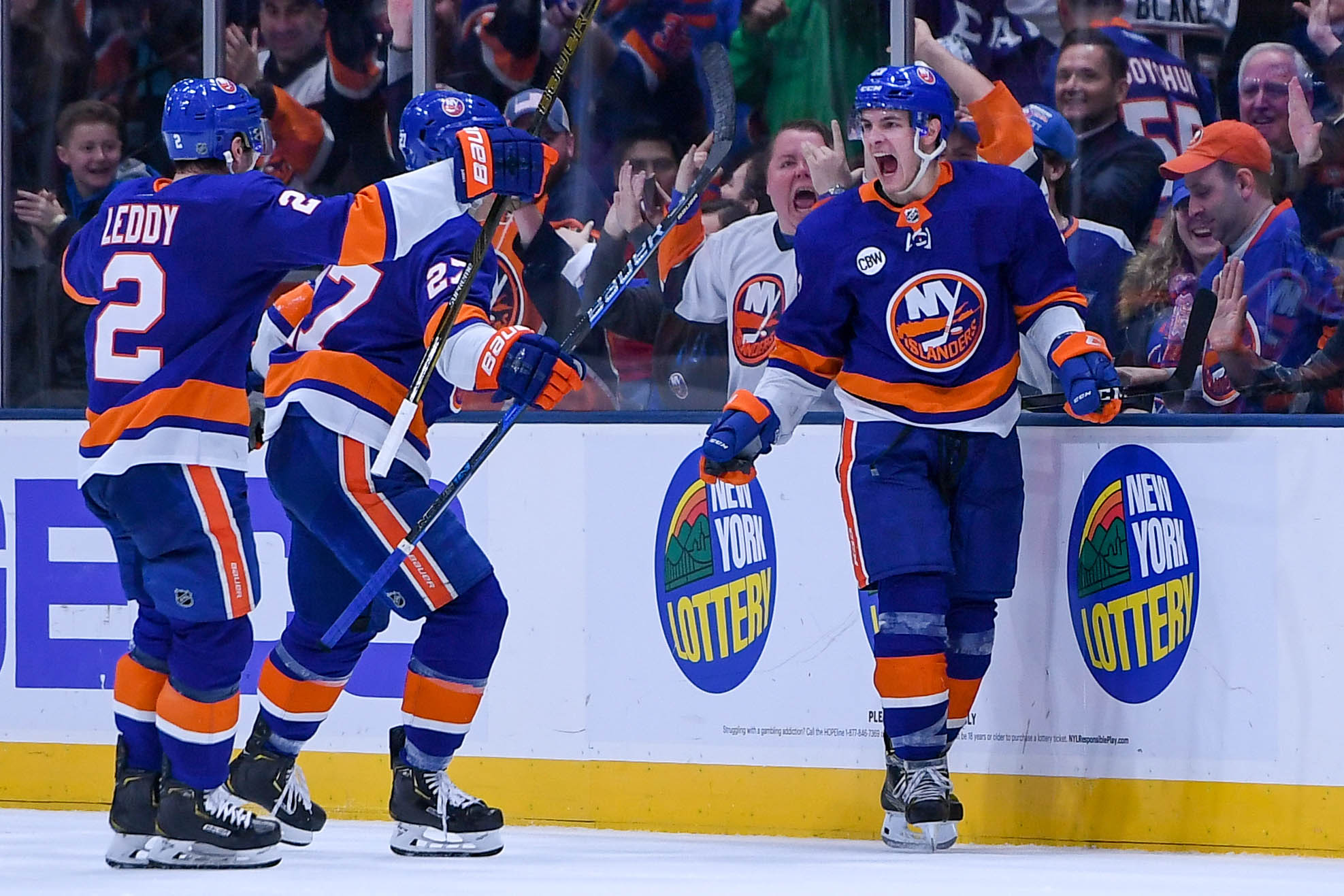 Dec 15, 2018; Uniondale, NY, USA; New York Islanders center Mathew Barzal (13) celebrates with New York Islanders defenseman Nick Leddy (2) and New York Islanders left wing Anders Lee (27) after scoring a goal against the Detroit Red Wings during the third period at Nassau Veterans Memorial Coliseum. Mandatory Credit: Dennis Schneidler-USA TODAY Sports