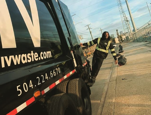 Look: Saints RB Alvin Kamara works as garbage man, rides on truck picking up trash