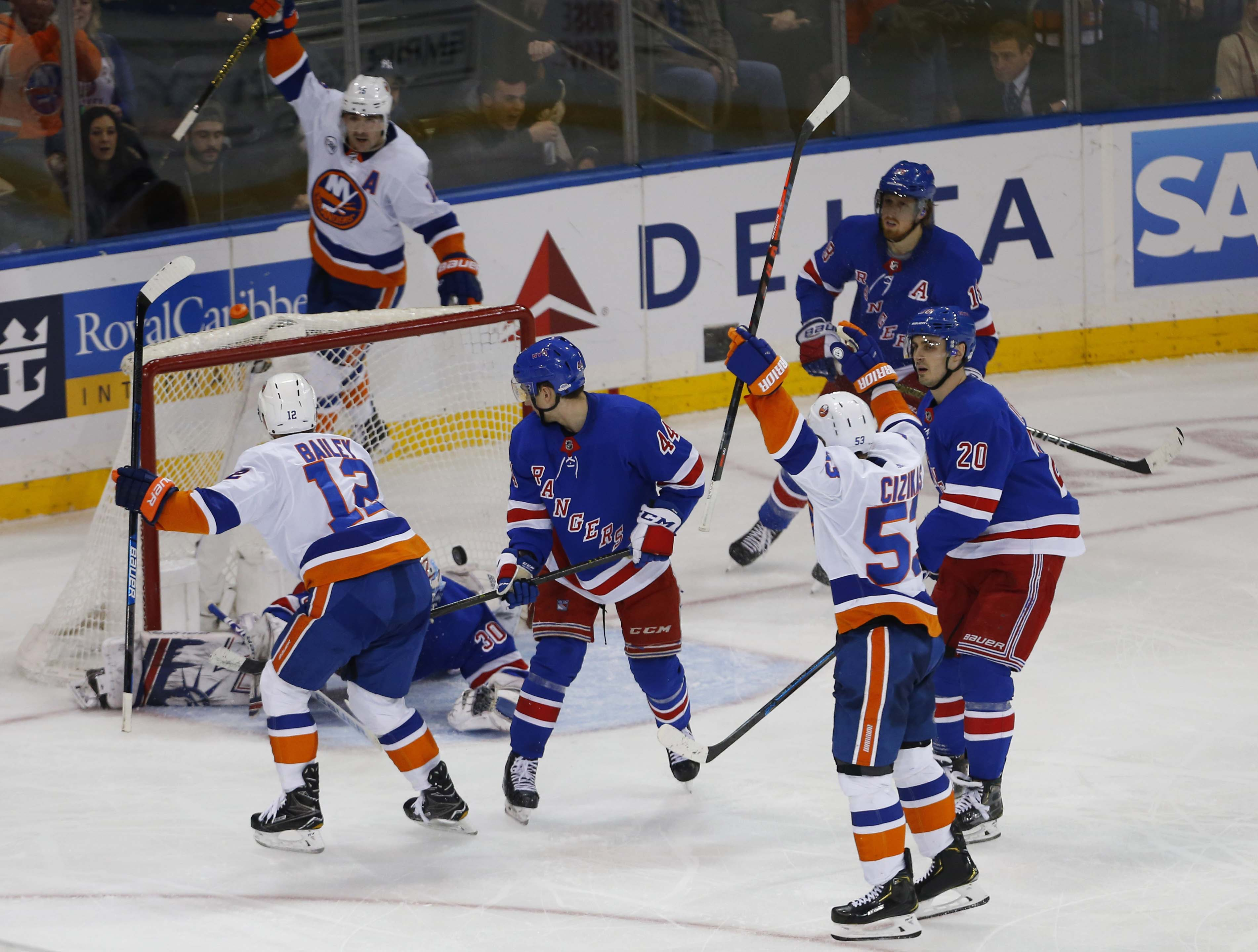 Jan 10, 2019; New York, NY, USA; New York Islanders right wing Josh Bailey (12) scores a goal the game winning goal against New York Rangers goaltender Henrik Lundqvist (30) during the third period at Madison Square Garden. The New York Islanders won 4-3.
