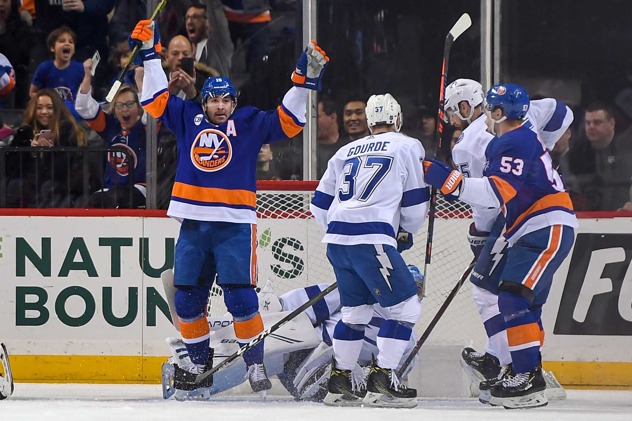 Jan 13, 2019; Brooklyn, NY, USA; New York Islanders right wing Cal Clutterbuck (15) celebrates his goal against theTampa Bay Lightning during the first period at Barclays Center. Mandatory Credit: Dennis Schneidler-USA TODAY Sports