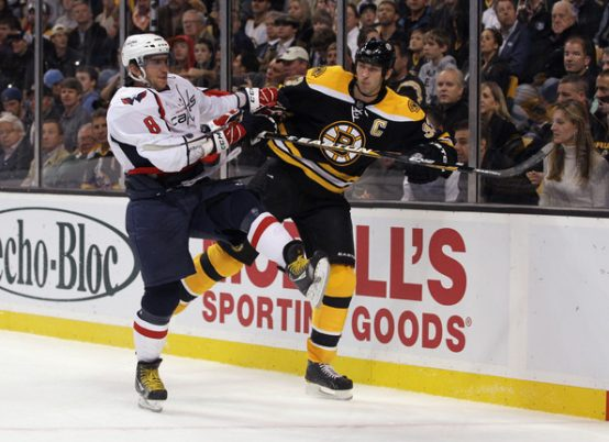 Watch: Alex Ovechkin Dumps Bruins' Giant Zdeno Chara Into Capitals' Bench