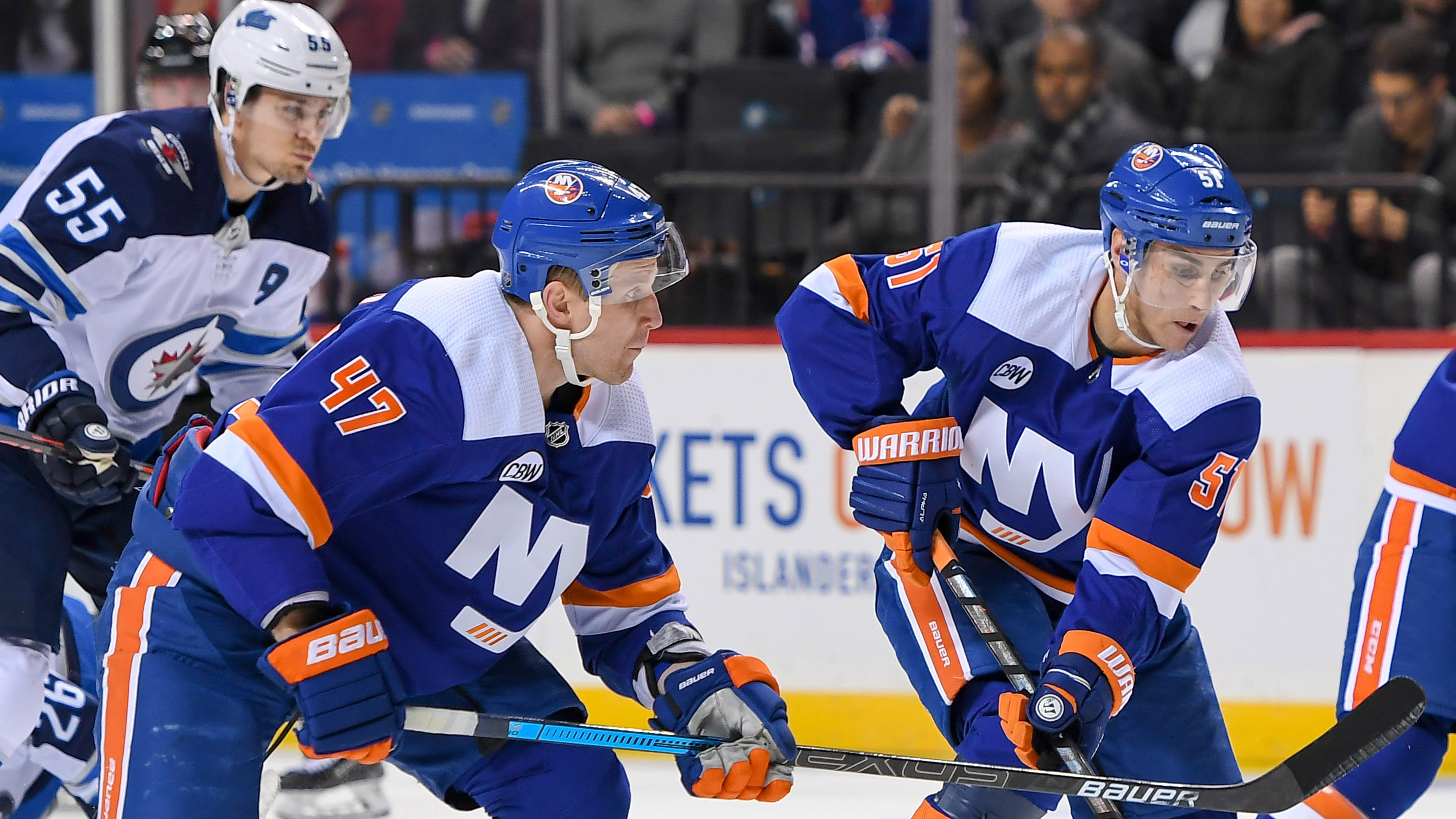 Dec 4, 2018; Brooklyn, NY, USA; New York Islanders center Valtteri Filppula (51) skates the puck across the blue line with New York Islanders right wing Tom Kuhnhackl (14) and New York Islanders right wing Leo Komarov (47) against the Winnipeg Jets during the second period at Barclays Center. Mandatory Credit: Dennis Schneidler-USA TODAY Sports