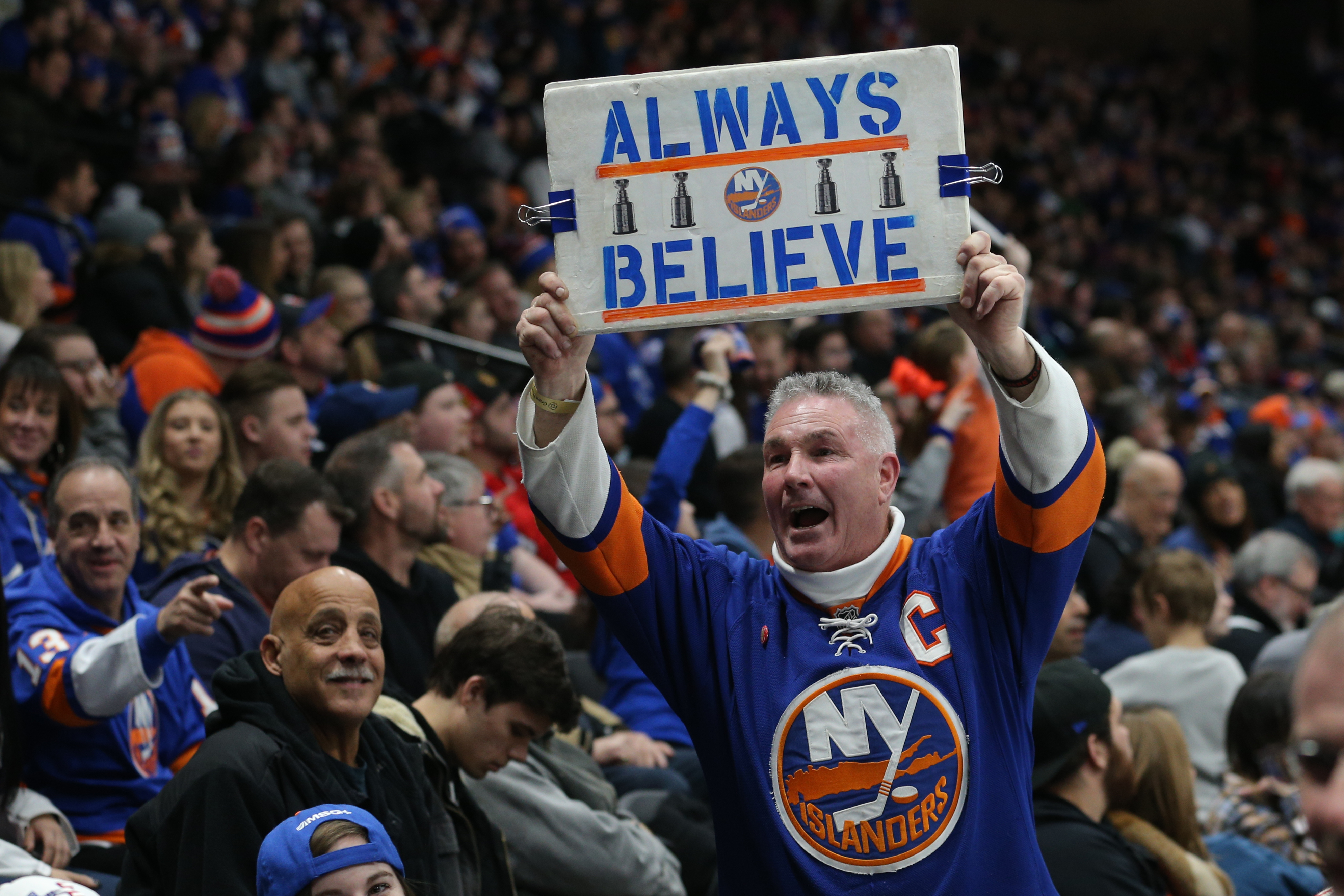 Feb 1, 2019; Uniondale, NY, USA; A fan of the New York Islanders displays a sign during the third period against the Tampa Bay Lightning at Nassau Veterans Memorial Coliseum. Mandatory Credit: Brad Penner-USA TODAY Sports