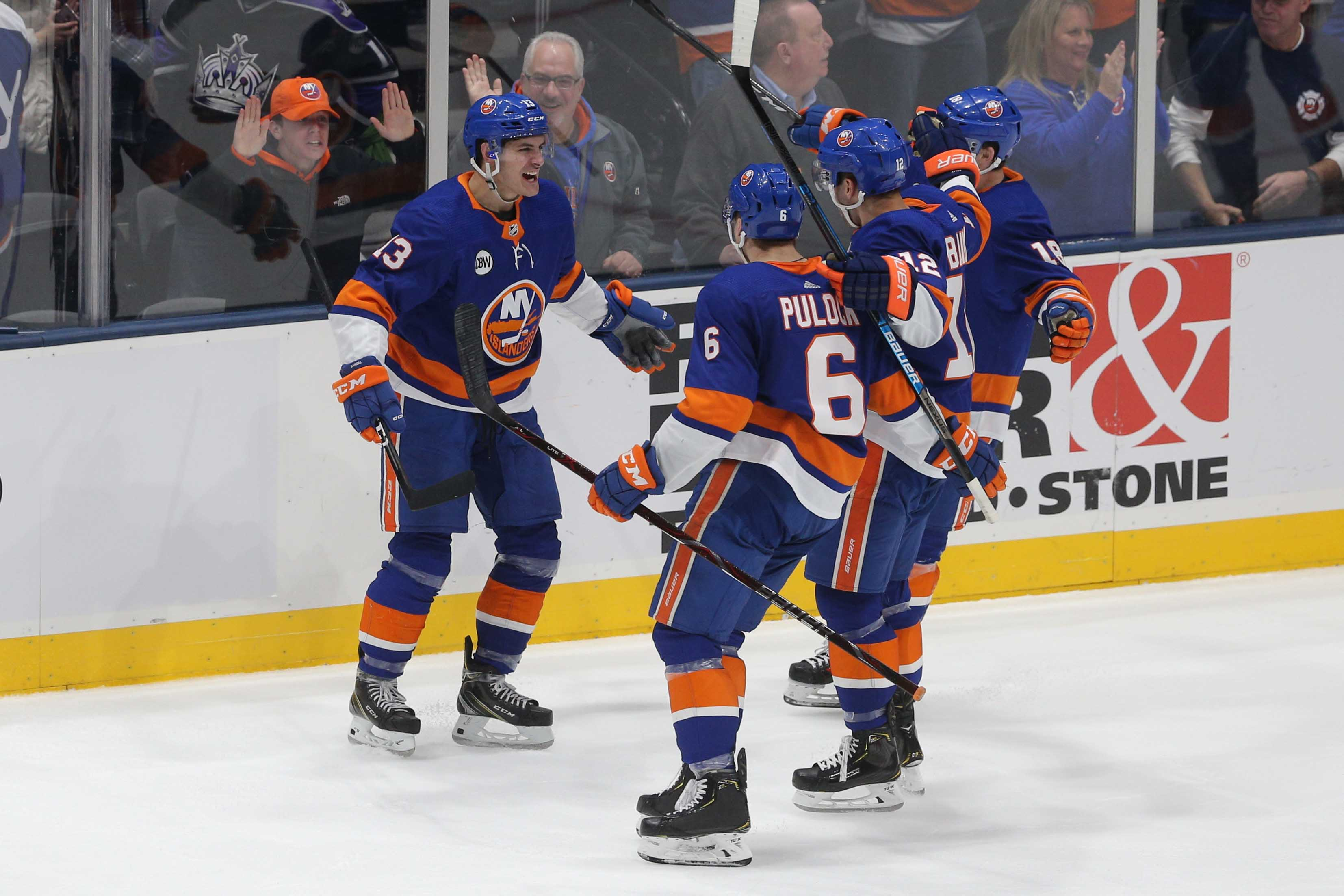 Feb 2, 2019; Uniondale, NY, USA; New York Islanders center Mathew Barzal (13) celebrates his game tying goal against the Los Angeles Kings with teammates during the third period at Nassau Veterans Memorial Coliseum. Mandatory Credit: Brad Penner-USA TODAY Sports