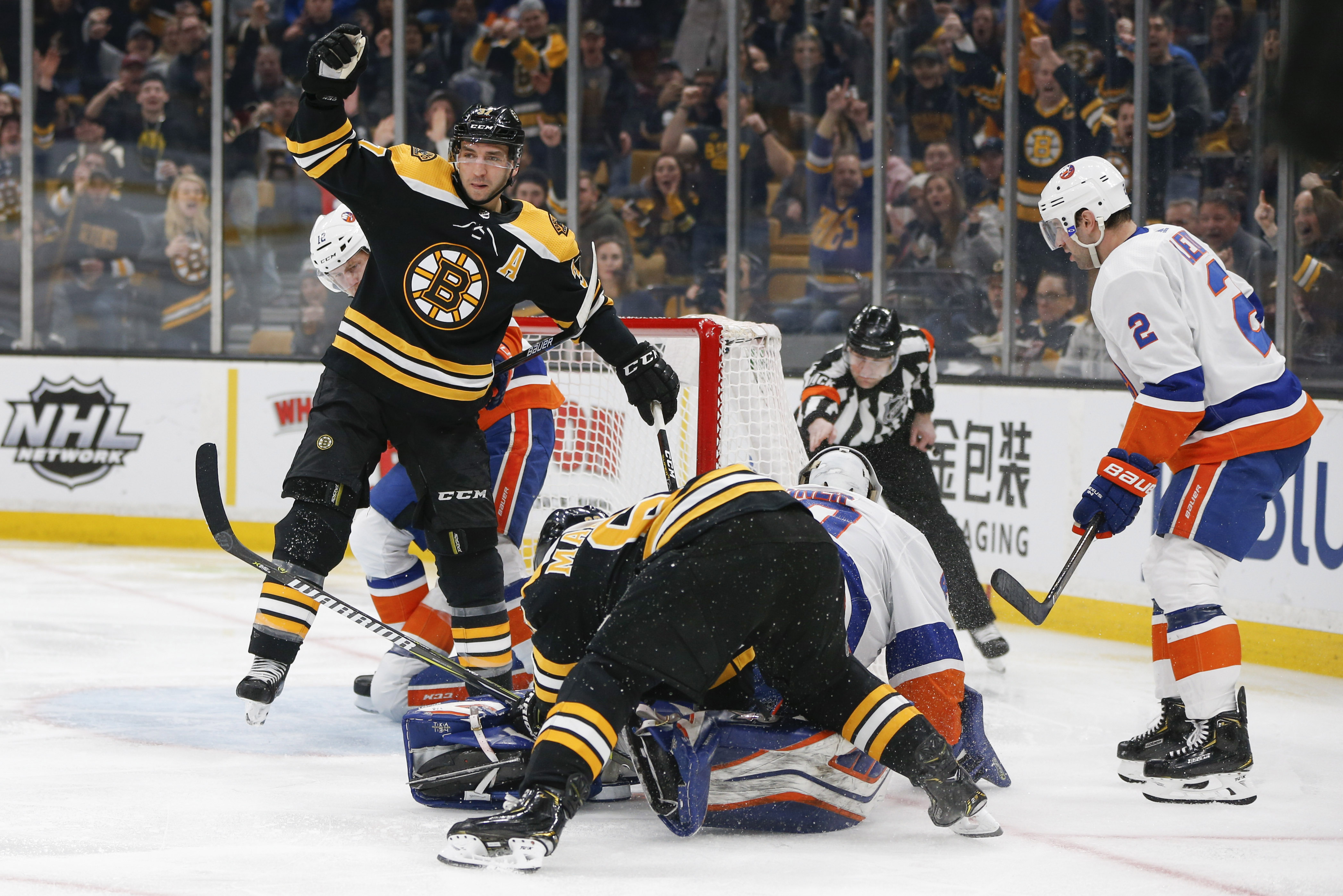 Feb 5, 2019; Boston, MA, USA; Boston Bruins center Patrice Bergeron (37) reacts after scoring a goal on New York Islanders goaltender Robin Lehner (40) during the second period at TD Garden. Mandatory Credit: Greg M. Cooper-USA TODAY Sports