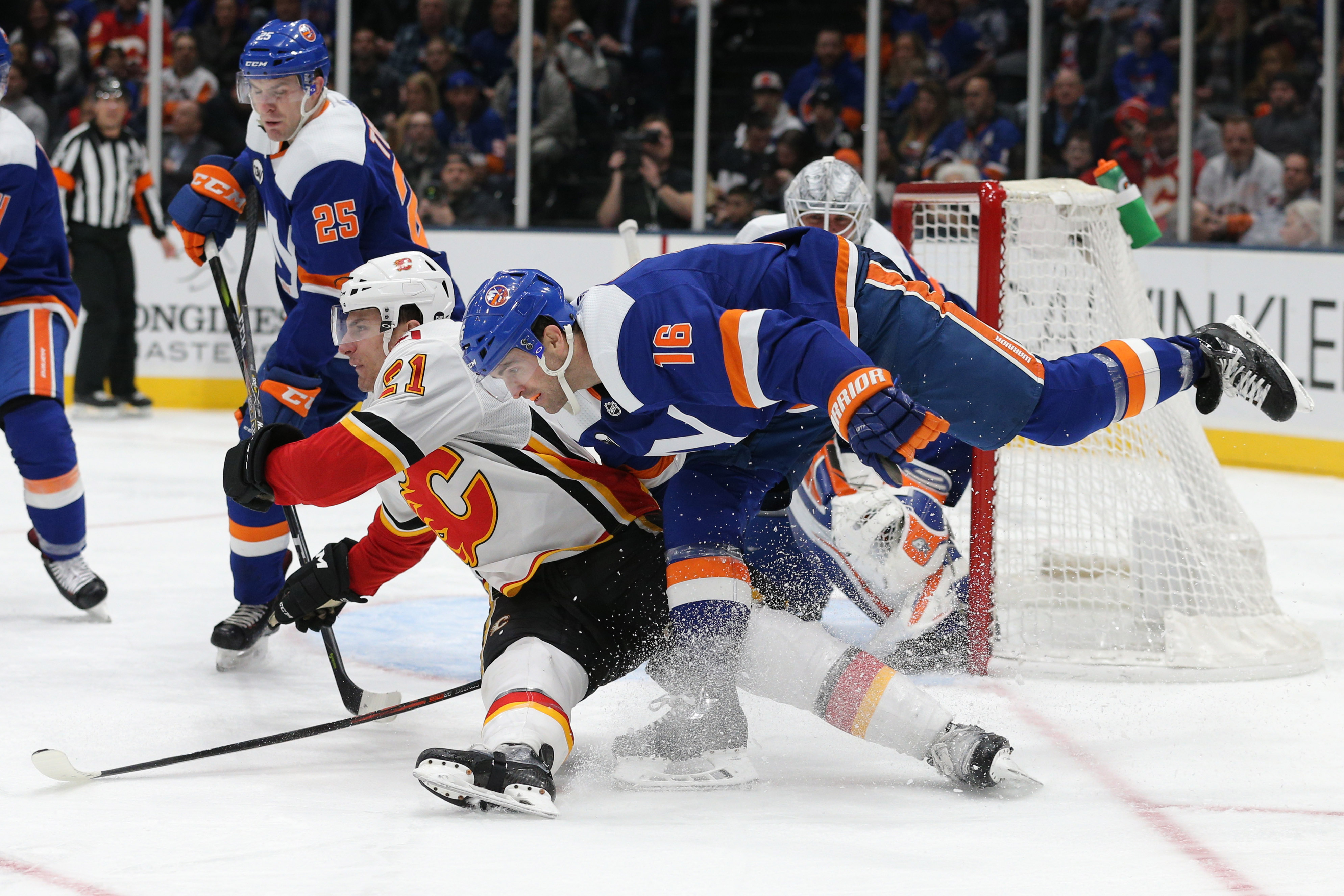 Feb 26, 2019; Uniondale, NY, USA; Calgary Flames right wing Garnet Hathaway (21) collides with New York Islanders left wing Andrew Ladd (16) during the third period at Nassau Veterans Memorial Coliseum. Mandatory Credit: Brad Penner-USA TODAY Sports