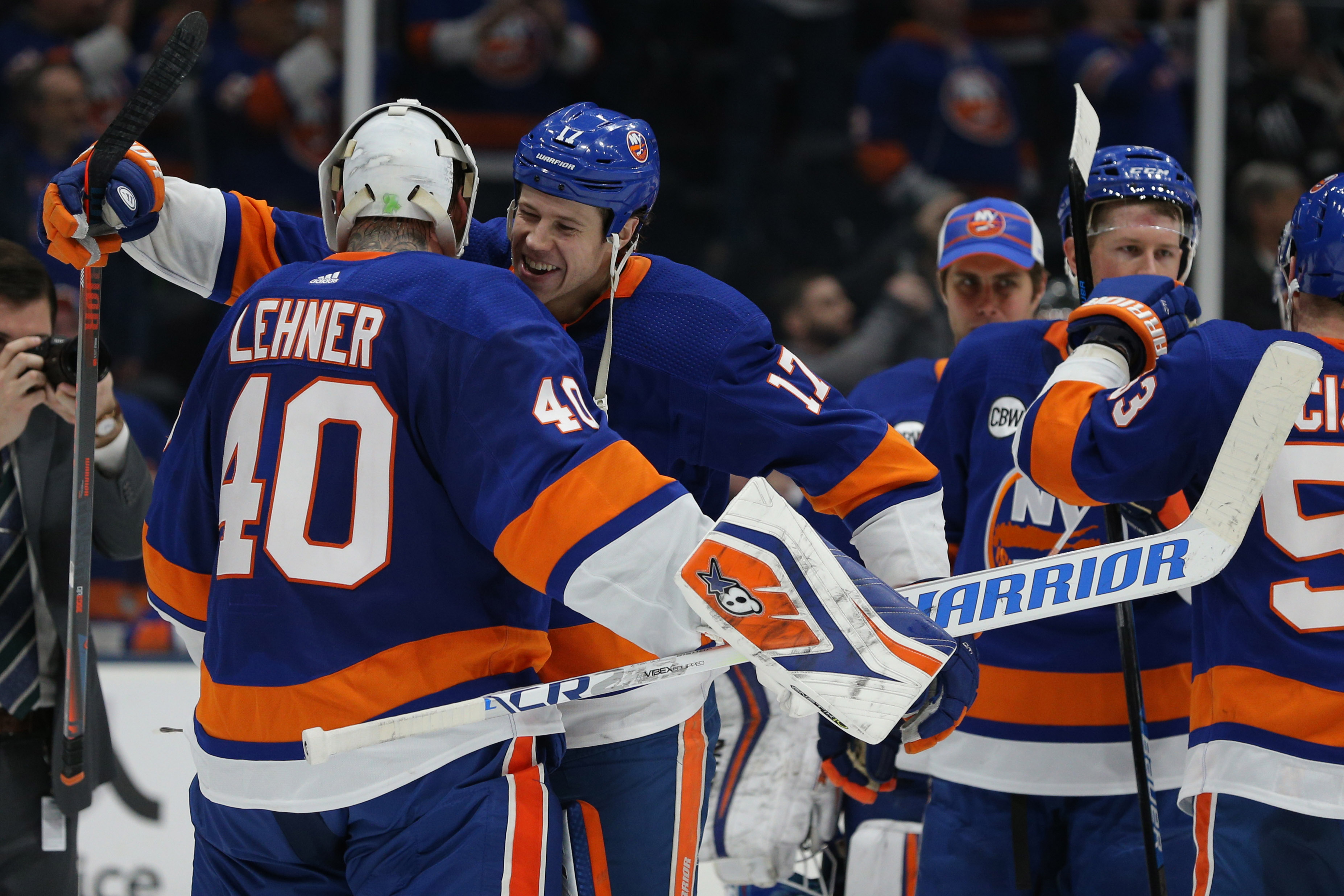 Feb 28, 2019; Brooklyn, NY, USA; New York Islanders left wing Matt Martin (17) celebrates with New York Islanders goalie Robin Lehner (40) after defeating the Toronto Maple Leafs at the Nassau Veterans Memorial Coliseum. Mandatory Credit: Brad Penner-USA TODAY Sports