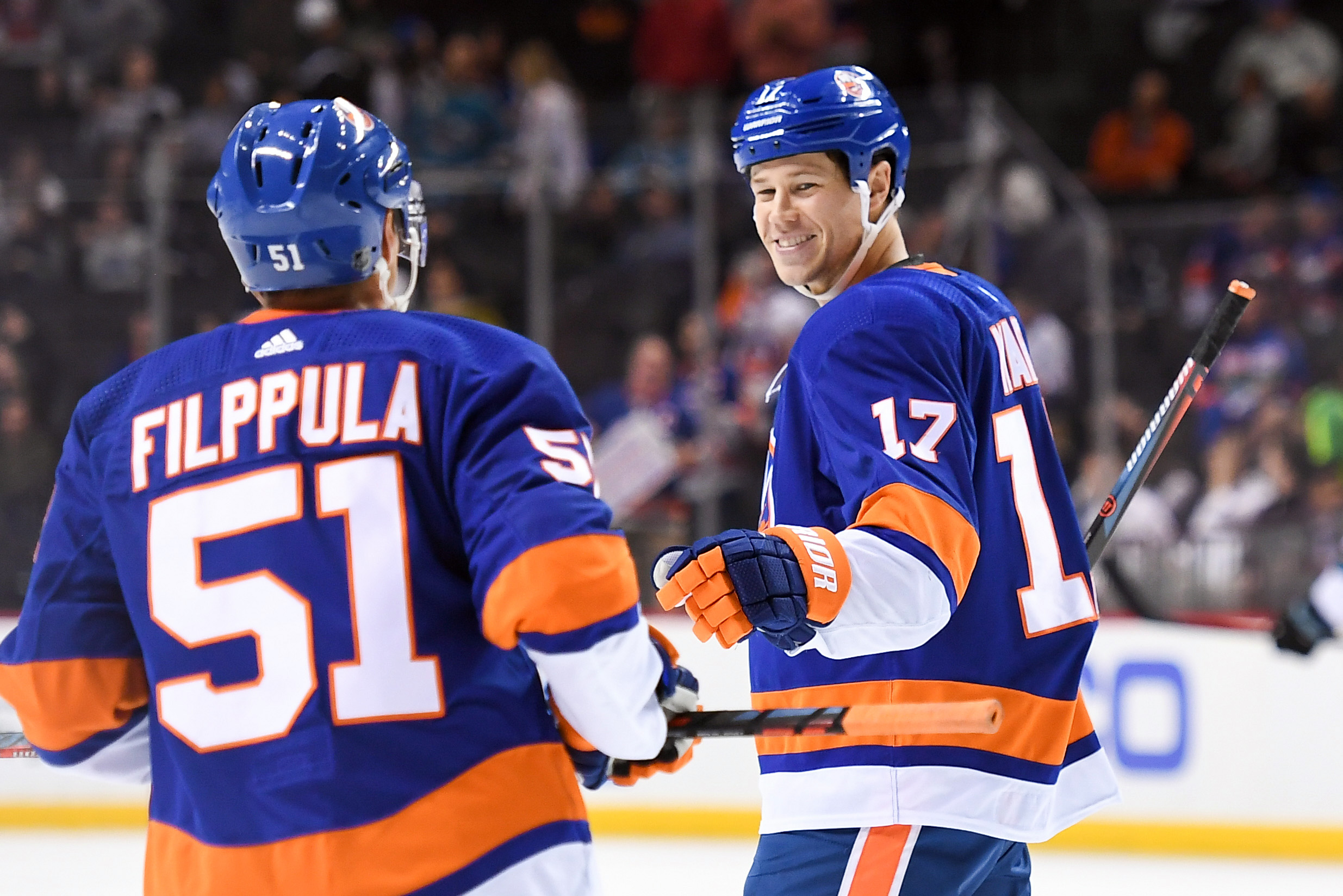 Oct 8, 2018; Brooklyn, NY, USA; New York Islanders left wing Matt Martin (17) celebrates his goal with New York Islanders center Valtteri Filppula (51) against the San Jose Sharks during the third period at Barclays Center. Mandatory Credit: Dennis Schneidler-USA TODAY Sports