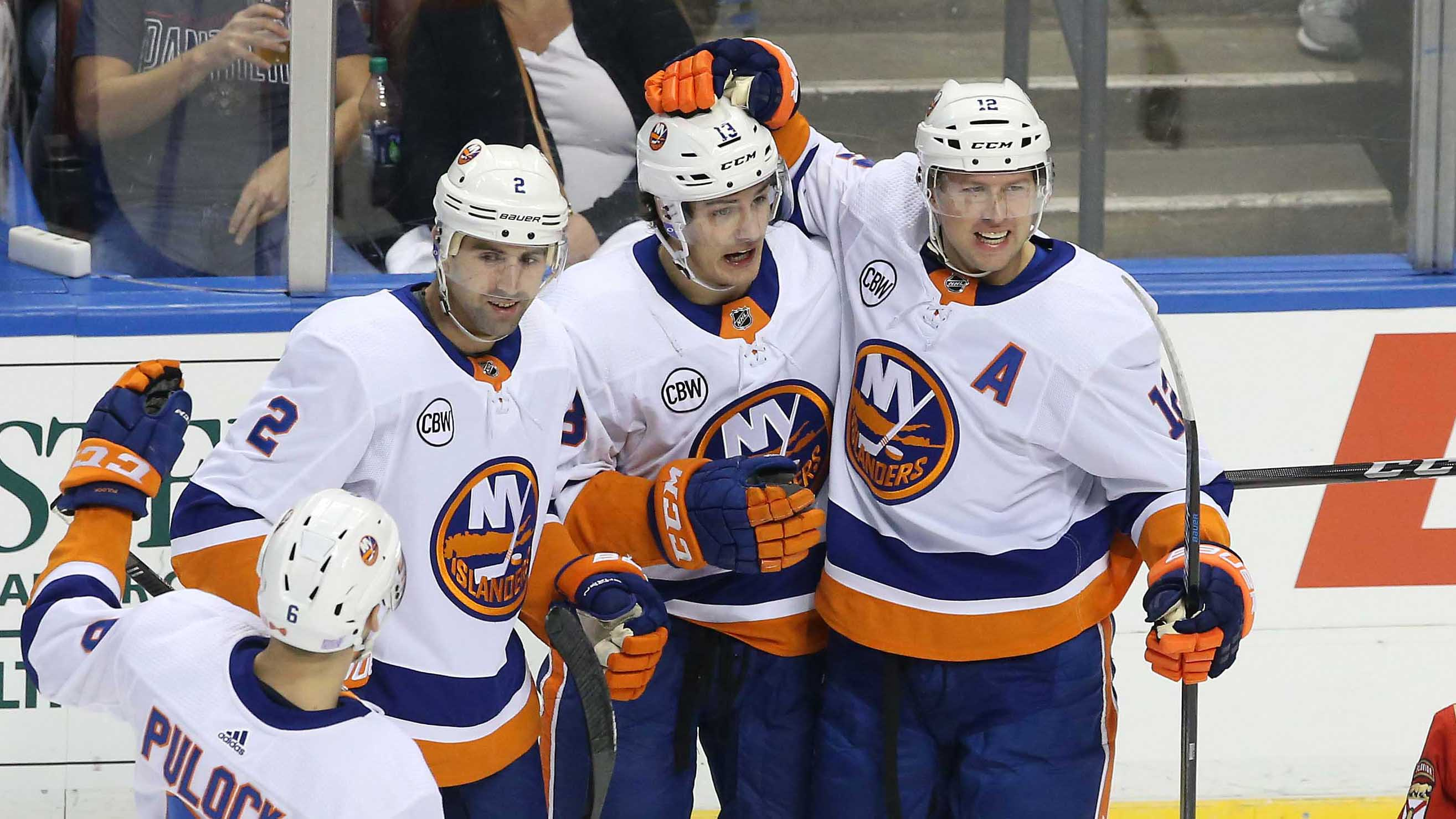 Nov 10, 2018; Sunrise, FL, USA; New York Islanders center Mathew Barzal (13) celebrates his goal against the Florida Panthers with left wing Josh Bailey (12) and defenseman Nick Leddy (2) in the first period at BB&T Center. Mandatory Credit: Robert Mayer-USA TODAY Sports